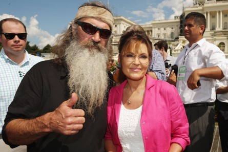 WASHINGTON, DC - SEPTEMBER 09:  Reality television personality Phil Robertson (L) and Sarah Palin pose for photographs during a rally against the Iran nuclear deal on the West Lawn of the U.S. Capitol September 9, 2015 in Washington, DC. Thousands of people gathered for the rally, organized by the Tea Party Patriots, which featured conservative pundits and politicians.  (Photo by Chip Somodevilla/Getty Images)