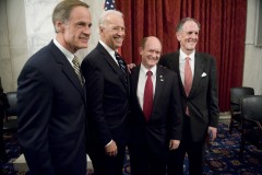 UNITED STATES - NOVEMBER 15:  From left, Sen. Tom Carper, D-Del., Vice President Joe Biden, Sen. Chris Coons, D-Del., and outgoing Senator Ted Kaufman pose for a picture at reception in Coons' honor in Russell Building.  (Photo By Tom Williams/Roll Call)