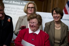 UNITED STATES - APRIL 01: Sen. Barbara Mikulski, D-Md., in red, Claire McCaskill, D-Mo., left, and Amy Klobuchar, D-Minn., share a laugh during a news conference in the Capitol to urge the Senate to pass the Paycheck Fairness Act which will help close the wage gap between men and women. (Photo By Tom Williams/CQ Roll Call)