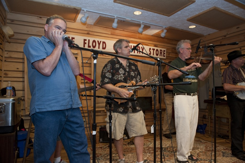 "UNITED STATES - August 10: Gov. Tim Kaine plays the harmonica for a packed house at the Floyd Country Store in Floyd Virginia. Gov. Kaine is campaigning in Southwest Virginia this weekend, including stops at the Floyd Country Store in Floyd and Barr's Fiddle Shop, the 77th Old Fiddler's Convention, and the Twin County Regional Chamber's annual ""Poor Man's Dinner"" in Galax Virginia. (Photo By Douglas Graham / CQ Roll Call)"