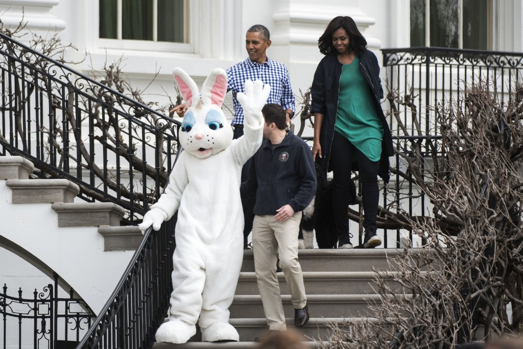 UNITED STATES - MARCH 28 - President Barack Obama and First Lady Michelle Obama walk down the stairs with the Easter Bunny during the White House Easter Egg Roll, on the South Lawn of the White House, in Washington, Monday, March 28, 2016. The first White House Easter Egg Roll was held in 1878 under President Rutherford B. Hayes. (Photo By Al Drago/CQ Roll Call)