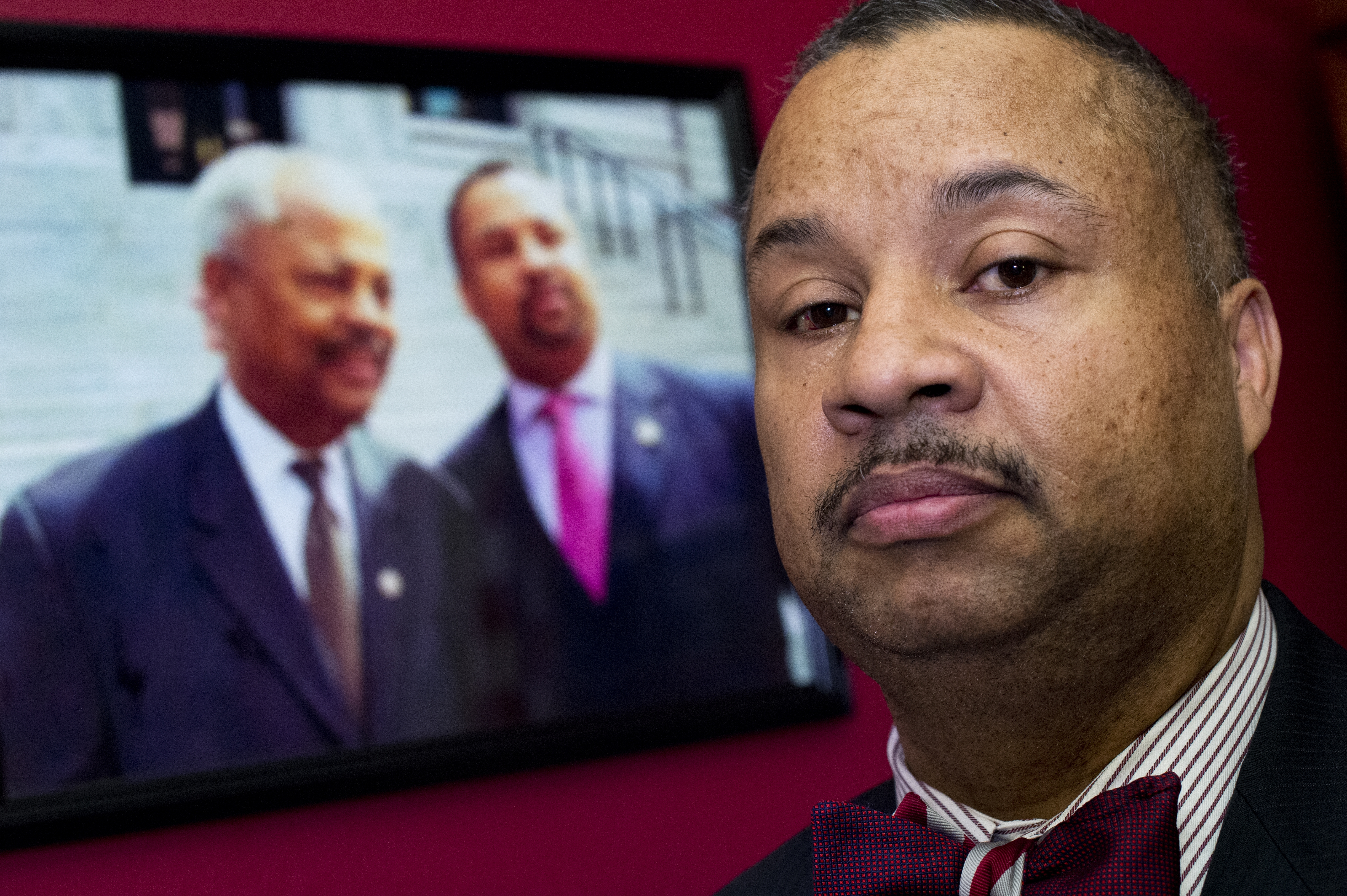 UNITED STATES - FEBRUARY 11: Rep. Donald Payne, Jr., D-N.J., is photographed in his Cannon Building office near a picture of himself and his late father former Rep. Donald Payne, D-N.J., February 11, 2016.(Photo By Tom Williams/CQ Roll Call)