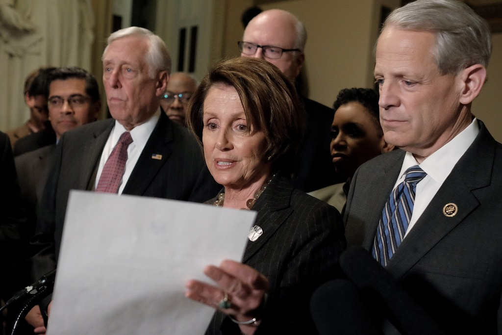 Nancy Pelosi and the team. (Credit: T.J. Kirkpatrick, Getty Images)