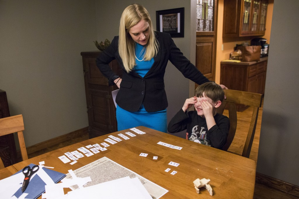 UNITED STATES - APRIL 6 - Indiana State Sen. Erin Houchin, works on spelling with her son, Graham, 7, after dinner in their home in Salem, Ind., Wednesday, April 6, 2016. Houchin is running as a Republican for Congress in the 9th congressional district. (Photo By Al Drago/CQ Roll Call)