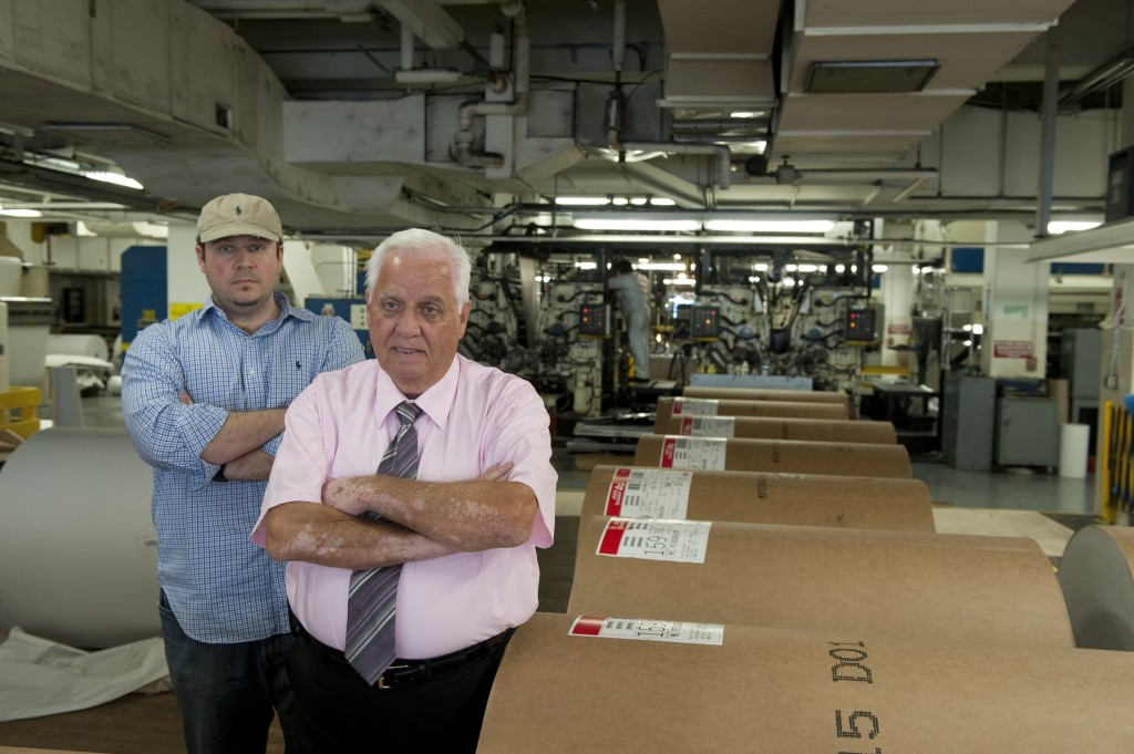 John Crawford with his son Nick at a printing plant of the U.S. Government Publishing Office in 2010. (CQ Roll Call File Photo)