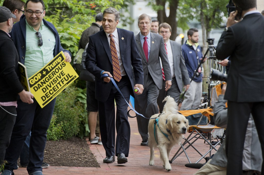 "Rep. Lou Barletta, R-Pa., walks his dog ""Reilly"" past media set up outside RNC. (Tom Williams/CQ Roll Call)"