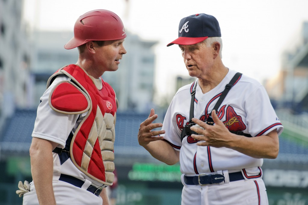 Reps. Rodney Davis, R-Ill., left, and Roger Williams, R-Texas, talk during the 54th Congressional Baseball Game in Nationals Park, June 11, 2015. The Democrats prevailed over the Republicans 5-2. (Photo By Tom Williams/CQ Roll Call)