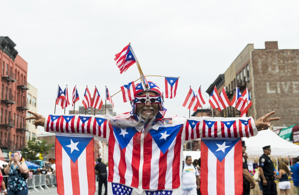 "UNITED STATES - JUNE 9: A man who identified himself as ""Castro"" shows off his Puerto Rican pride at the Annual 116th Street Festival, billed as the largest Latin festival in the northeast, in East Harlem on Saturday, June 9, 2012. New York state senator Adriano Espaillat spoke to the crowd of thousands and waded into the crowd to shake hands. His opponent in the Democratic primary race, Rep. Charlie Rangel, D-NY, was scheduled to speak at the festival, but did not show up. (Photo By Bill Clark/CQ Roll Call)"