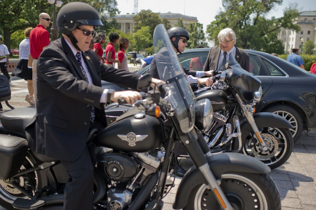 Davidson motorcycles of Reps. Reid Ribble of Wisconsin left, and Scott Rigell of Virginia outside the Capitol on Thursday. (Tom Williams/CQ Roll Call)