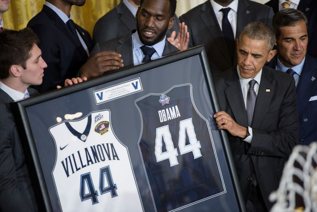 President Barack Obama is presented with jerseys from the NCAA basketball champion Villanova Wildcats at the White House. (Brendan Smialowski/AFP/Getty Images)