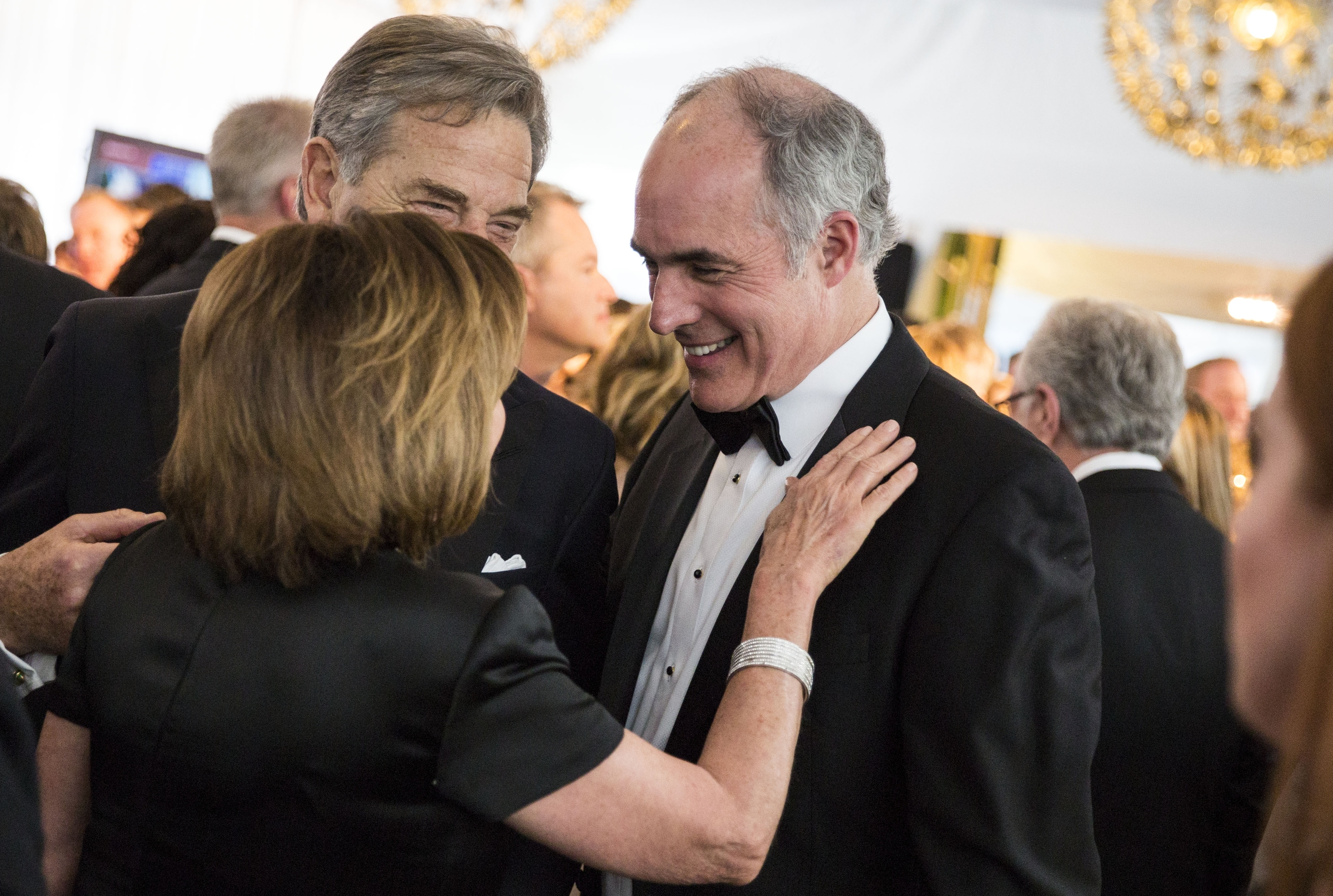 House Minority Leader Nancy Pelosi of California speaks with Pennsylvania Sen. Bob Casey, right, and her husband, Paul, at an Atlantic / CBS News pre-party on Saturday. (Photo By Al Drago/CQ Roll Call)