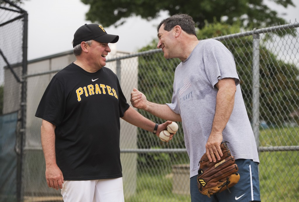 Coach Mike Doyle of Pennsylvania, talks with Indiana Sen. Joe Donnelly during a Democratic congressional baseball practice in 2013. (Tom Williams/CQ Roll Call File Photo)