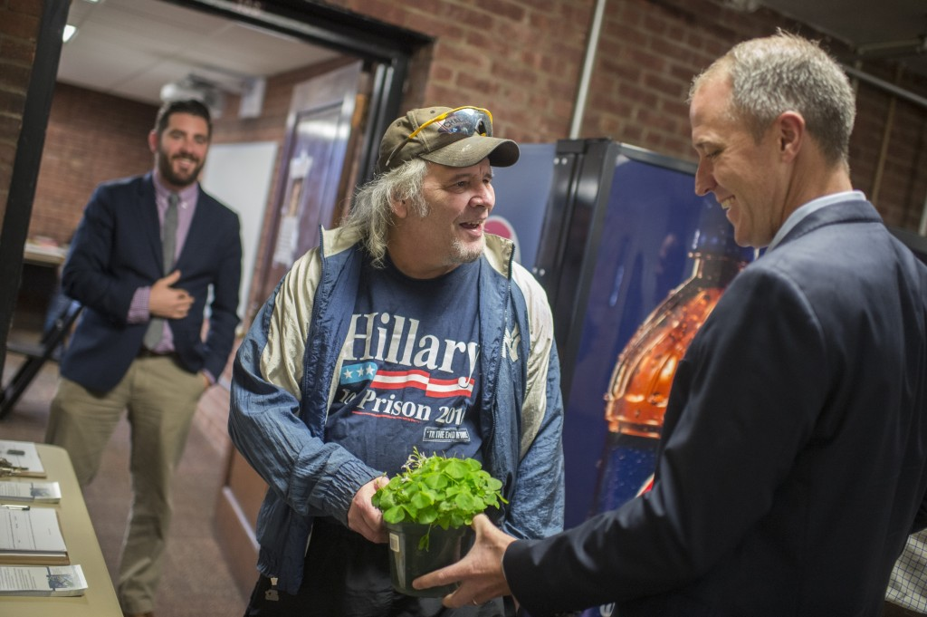 Rep. Sean Patrick Maloney, right, receives a pot of clover from constituent Michael Maroon, 61, to honor the congressman's Irish heritage at a town hall meeting in Newburgh, N.Y. on Saturday. (Tom Williams/CQ Roll Call)