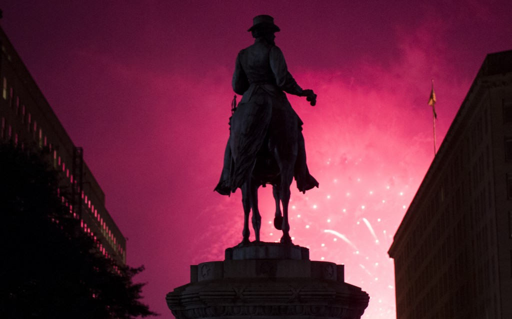 UNITED STATES - JULY 4: The statue of Gen. James McPherson, in McPherson Square near the White House, is silhouetted by the Independence Day fireworks on the National Mall on July 4, 2015.(Photo By Bill Clark/CQ Roll Call)