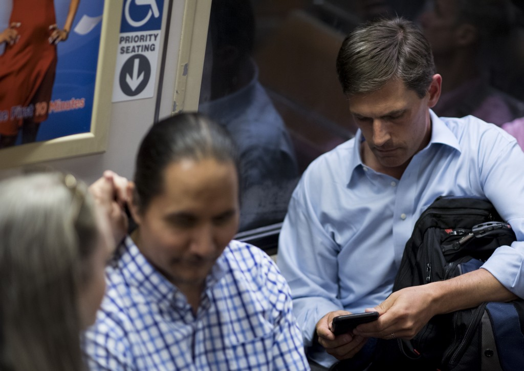 UNITED STATES - JUNE 28: Sen. Martin Heinrich (D-NM) rides the Metro home form the Capitol on Tuesday, June 28, 2016. (Photo By Bill Clark/CQ Roll Call)