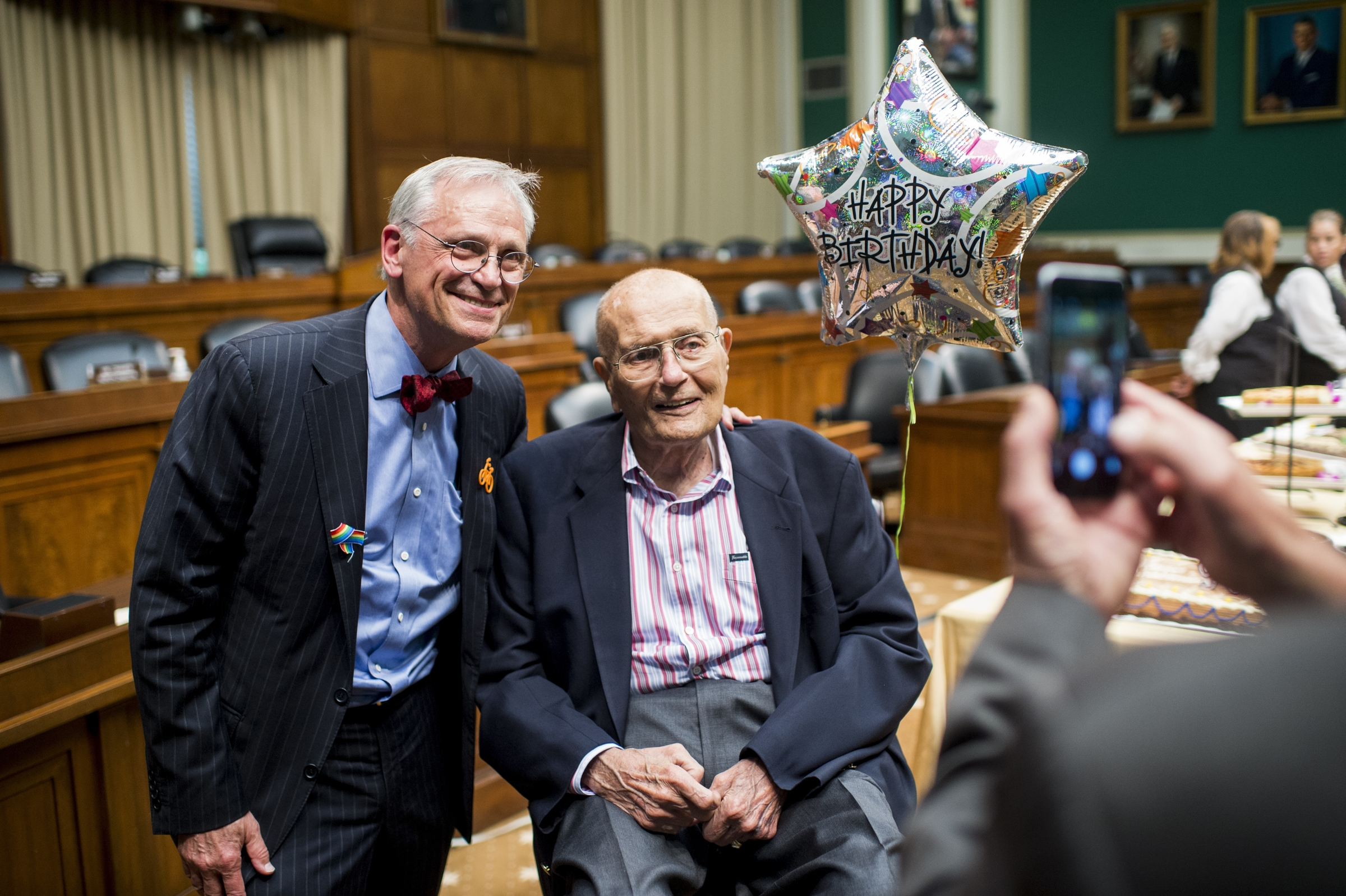 UNITED STATES - JULY 6: Rep. Earl Blumenauer, D-Ore., poses with former Rep. John Dingell, D-Mich., as Rep. Richard Hanna, R-N.Y., takes their photo in the House Energy and Commerce Committee hearing room, also known as the John Dingell Room, on Wednesday, July 6, 2016. Dingell is celebrating his 90th birthday. In the background are Reps. Joe Barton, R-Texas and Gene Green, D-Texas. (Photo By Bill Clark/CQ Roll Call)