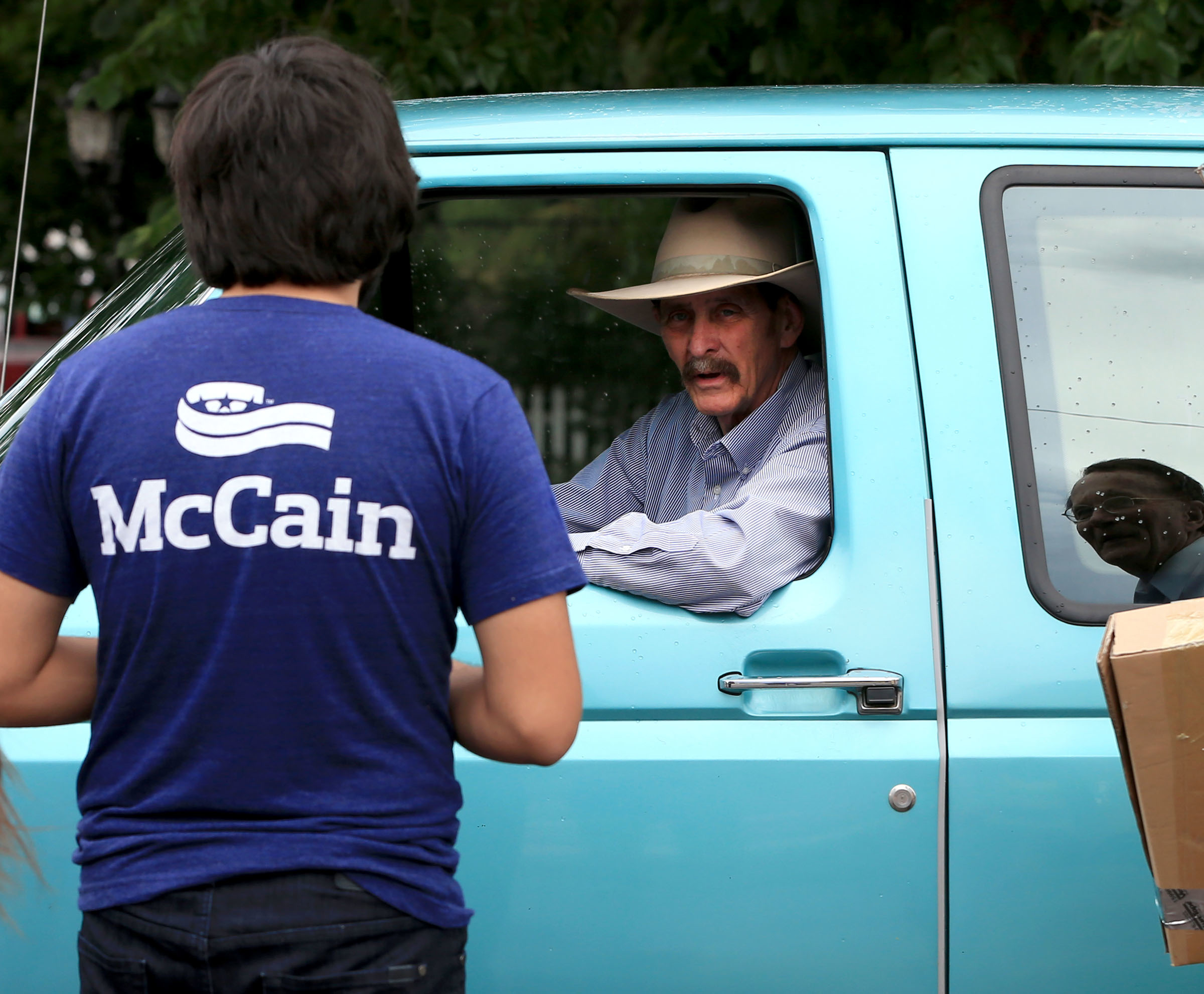 John Moore, mayor of Williams, Arizona, meets McCain campaign interns during their canvasing Tuesday. (Daniel A. Anderson)