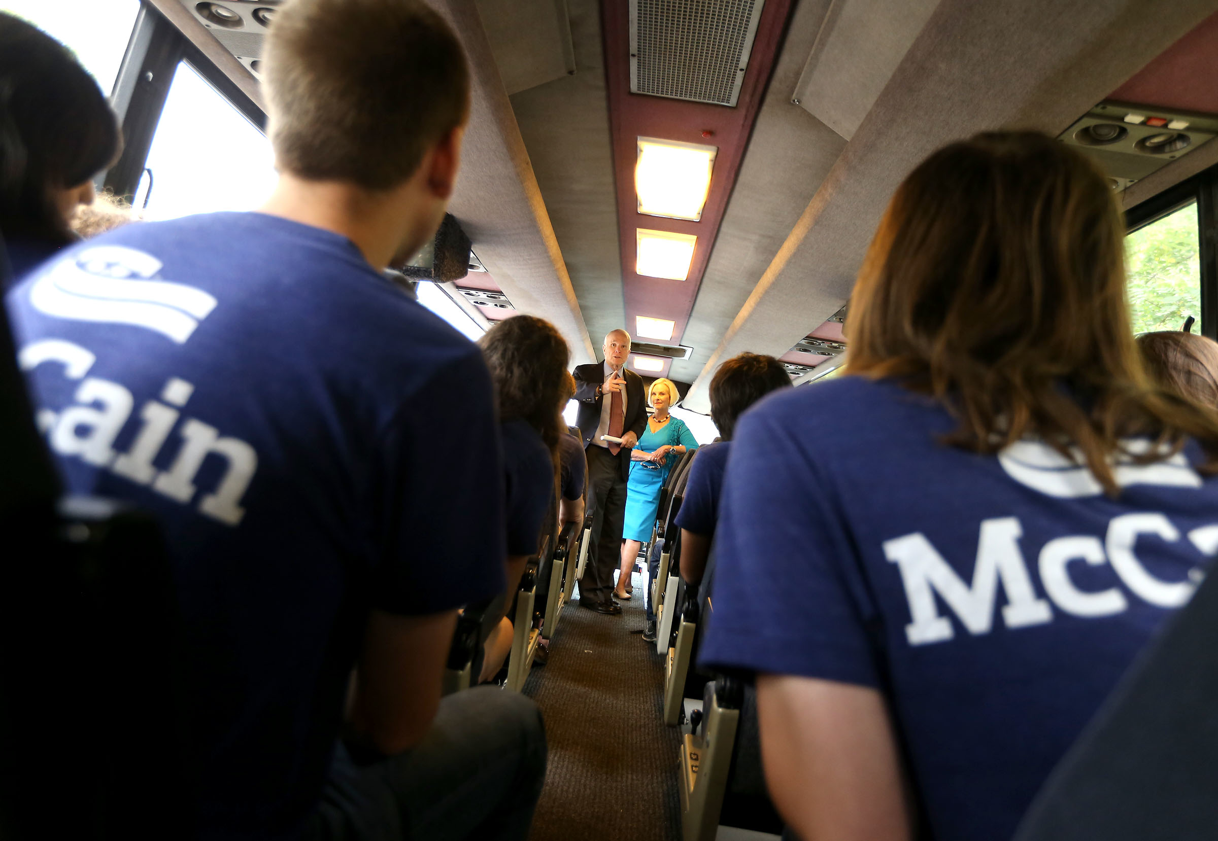 United States Senator John McCain rallies his interns on a campaign bus in Flagstaff Tuesday on a break from a door to door get out the vote effort by the campaign to reelect McCain. His wife, Cindy is at his side. (Daniel A. Anderson) John Sidney McCain III (born August 29, 1936) is the senior United States Senator from Arizona. (Photograph by Daniel A. Anderson)