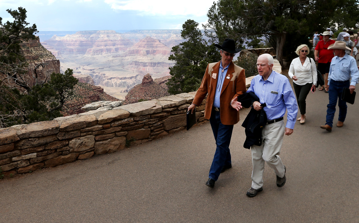 State Rep. Bob Thorpe, center, speaks with Sen. John McCain on the way to a meeting about the Grand Canyon watershed. (Daniel A. Anderson for CQ Roll Call)