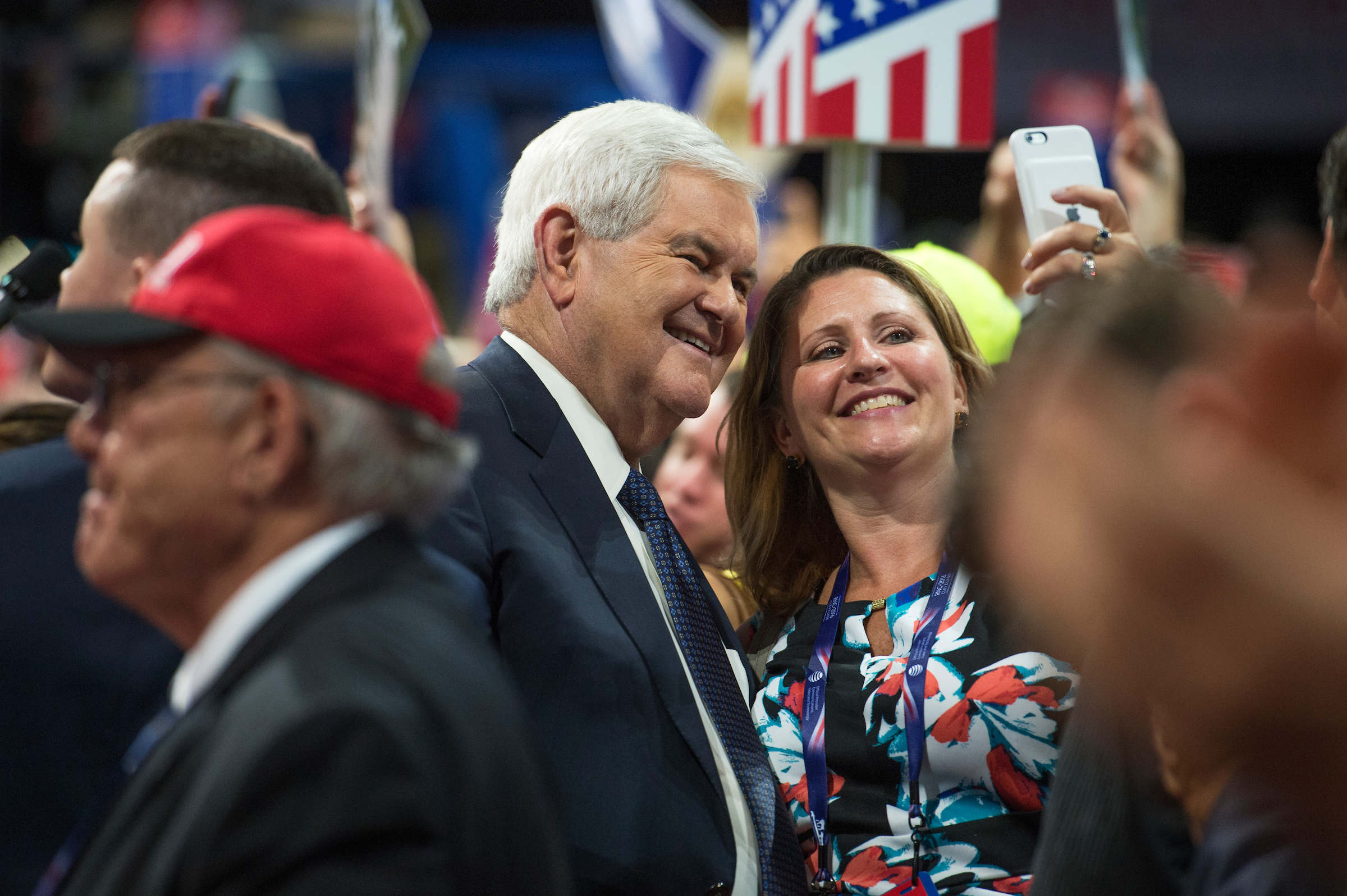 Former House Speaker Newt Gingrich takes pictures with a guest at the Republican National Convention in Cleveland last week. (Tom Williams/CQ Roll Call)