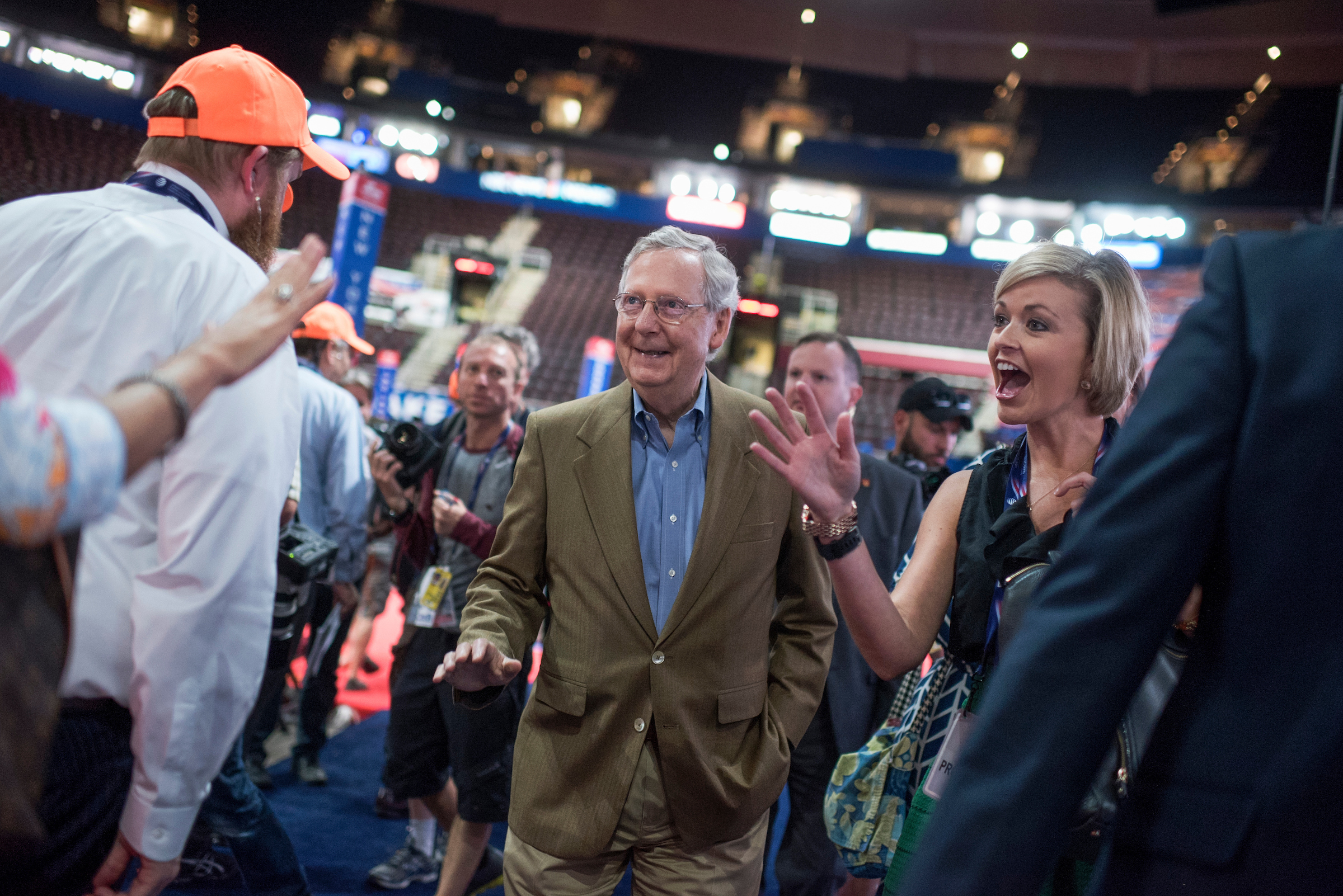 Senate Majority Leader Mitch McConnell, center, talks with guests at the Republican convention last week. (Tom Williams/CQ Roll Call)