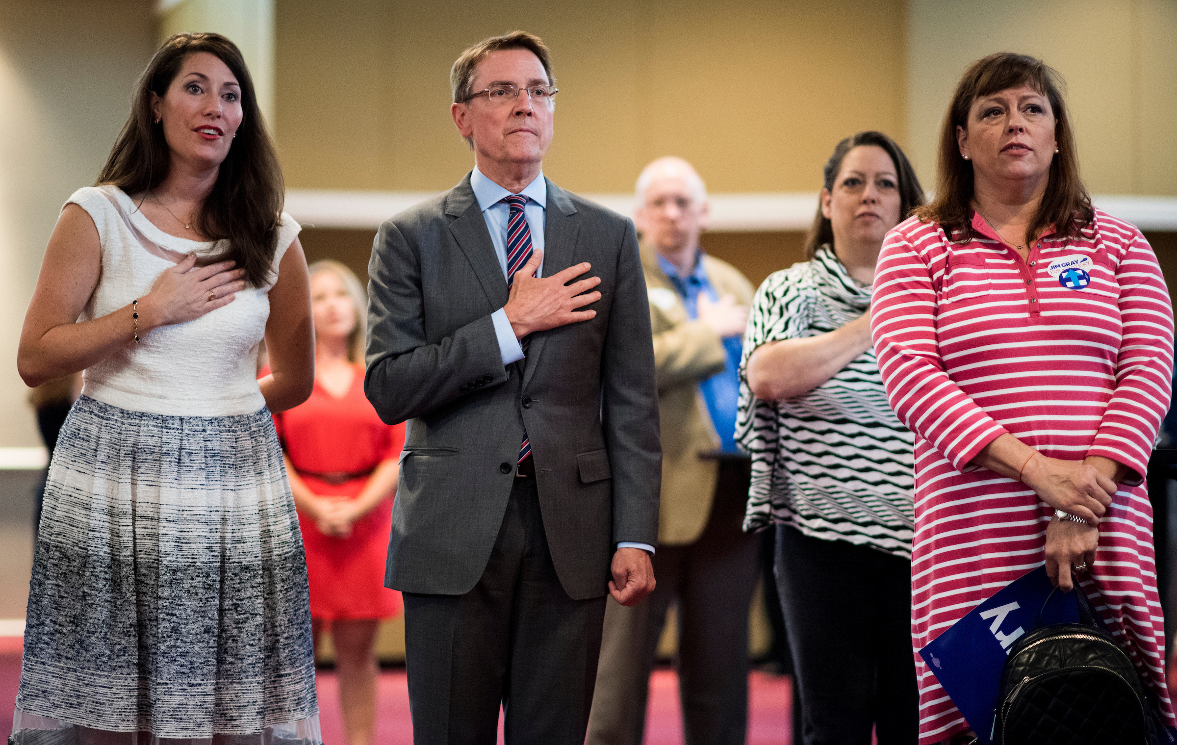 U.S. Senate candidate Jim Gray, center, and Kentucky Secretary of State Alison Lundergan Grimes, left, stand during the Pledge of Allegiance at the 11th annual Alben Barkley Dinner hosted by the McCracken County Democrats in Paducah, Kentucky, on Thursday, Aug. 4, 2016. (Bill Clark/CQ Roll Call)