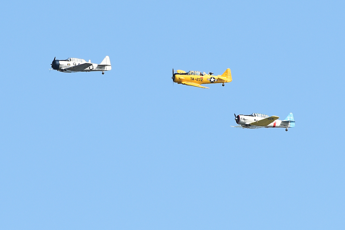Three T-6 Texan aircraft flyover the graveside service for Women Airforce Service Pilot (WASP) Elaine Harmon, at Arlington National Cemetery, Sept. 7, 2016. Citing space issues, WASPs were initially ineligible for inclusion at Arlington but after a petition challenging the rule, President Obama signed legislation that reversed it. Elaine Harmon passed away last year at age 95. (Tom Williams/CQ Roll Call)