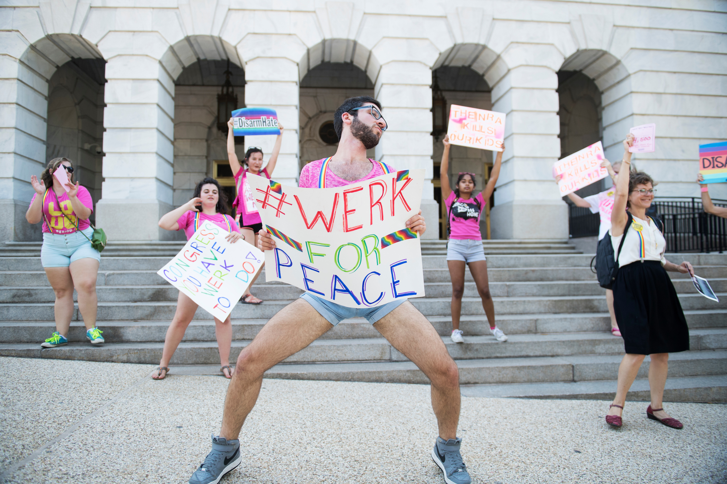 Firas Nasr of WERK for Peace, dances along Independence Avenue near Longworth Building to draw attention to deaths by gun violence that occurred while Congress was in recess, Sept. 6, 2016. (Tom Williams/CQ Roll Call)