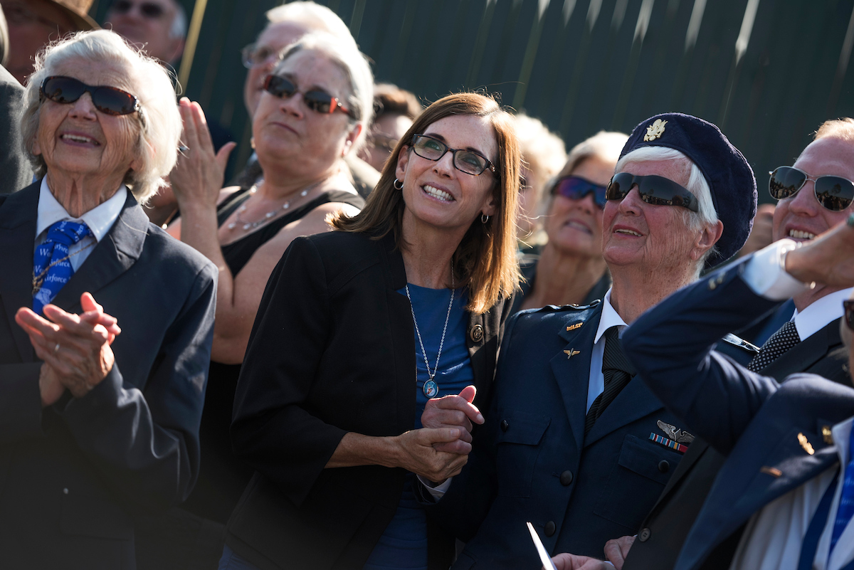 Rep. Martha McSally, R-Ariz., center, and former Women Airforce Service Pilot (WASP) Shutsy Reynolds, 93, right, watch a flyover before a graveside service for WASP Elaine Harmon, at Arlington National Cemetery, Sept. 7, 2016. (Tom Williams/CQ Roll Call)