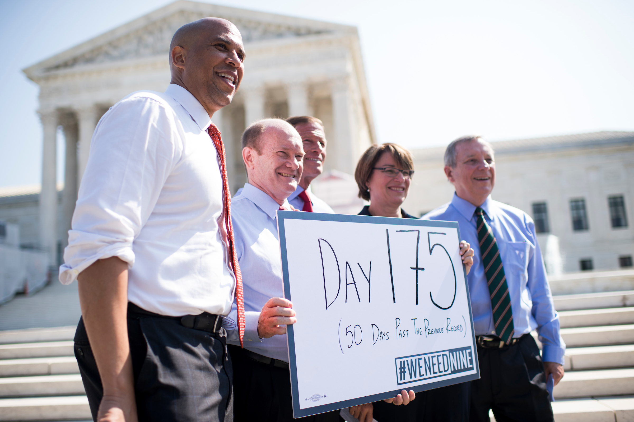 "From left, Sen. Cory Booker, D-N.J., Sen. Chris Coons, D-Del., Sen. Richard Blumenthal, D-Conn., Sen. Amy Klobuchar, D-Minn., and Sen. Richard Durbin, D-Ill., hold a sign which reads ""Day 175"" before their press conference on Sept. 7, 2016, to call on senators to give Supreme Court nominees Judge Merrick Garland a hearing and vote. (Bill Clark/CQ Roll Call)"