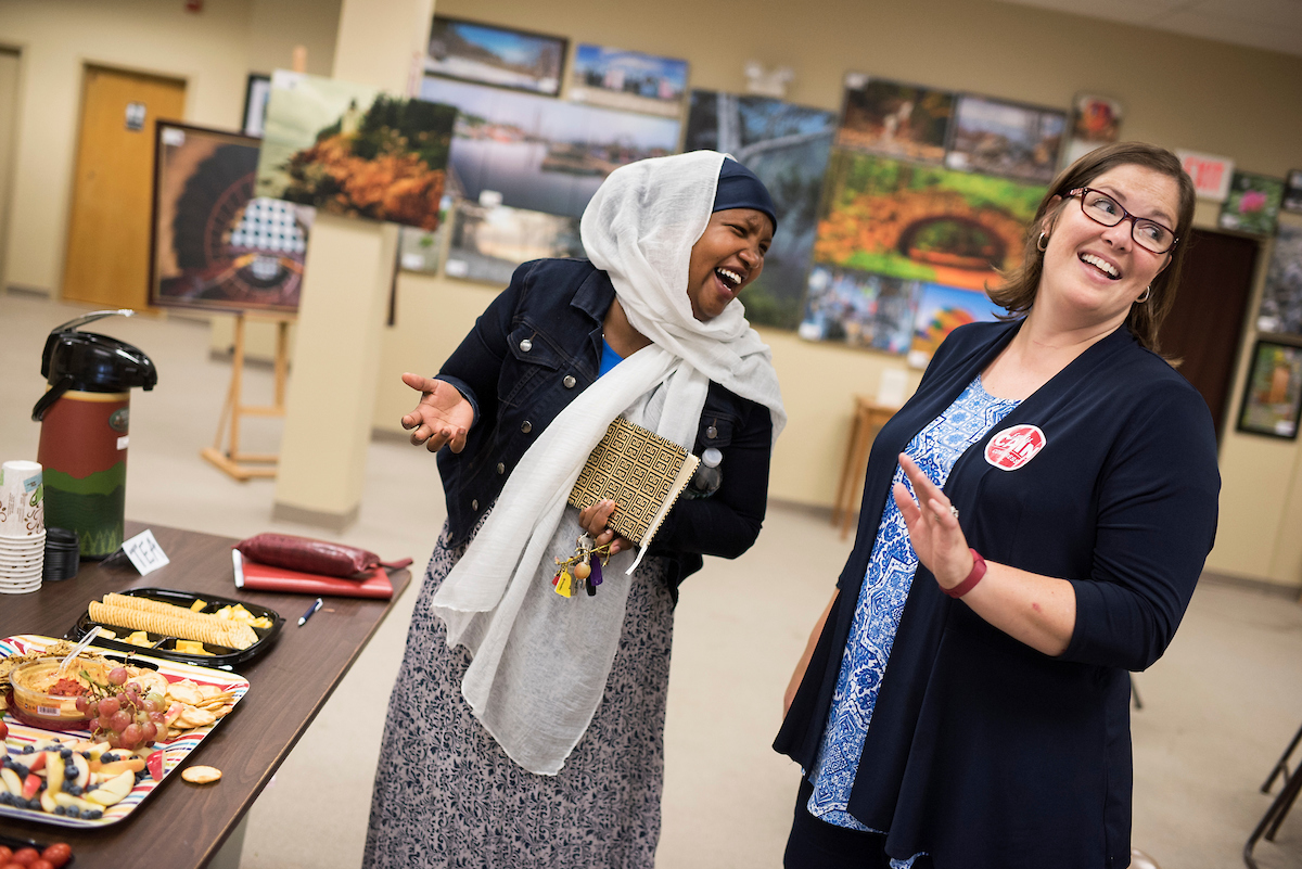Emily Cain, right, Democratic candidate for Maine's 2nd Congressional District, talks with Fatuma Hussein from Somalia, in Lewiston, Maine, Sept. 8, 2016. (Tom Williams/CQ Roll Call)