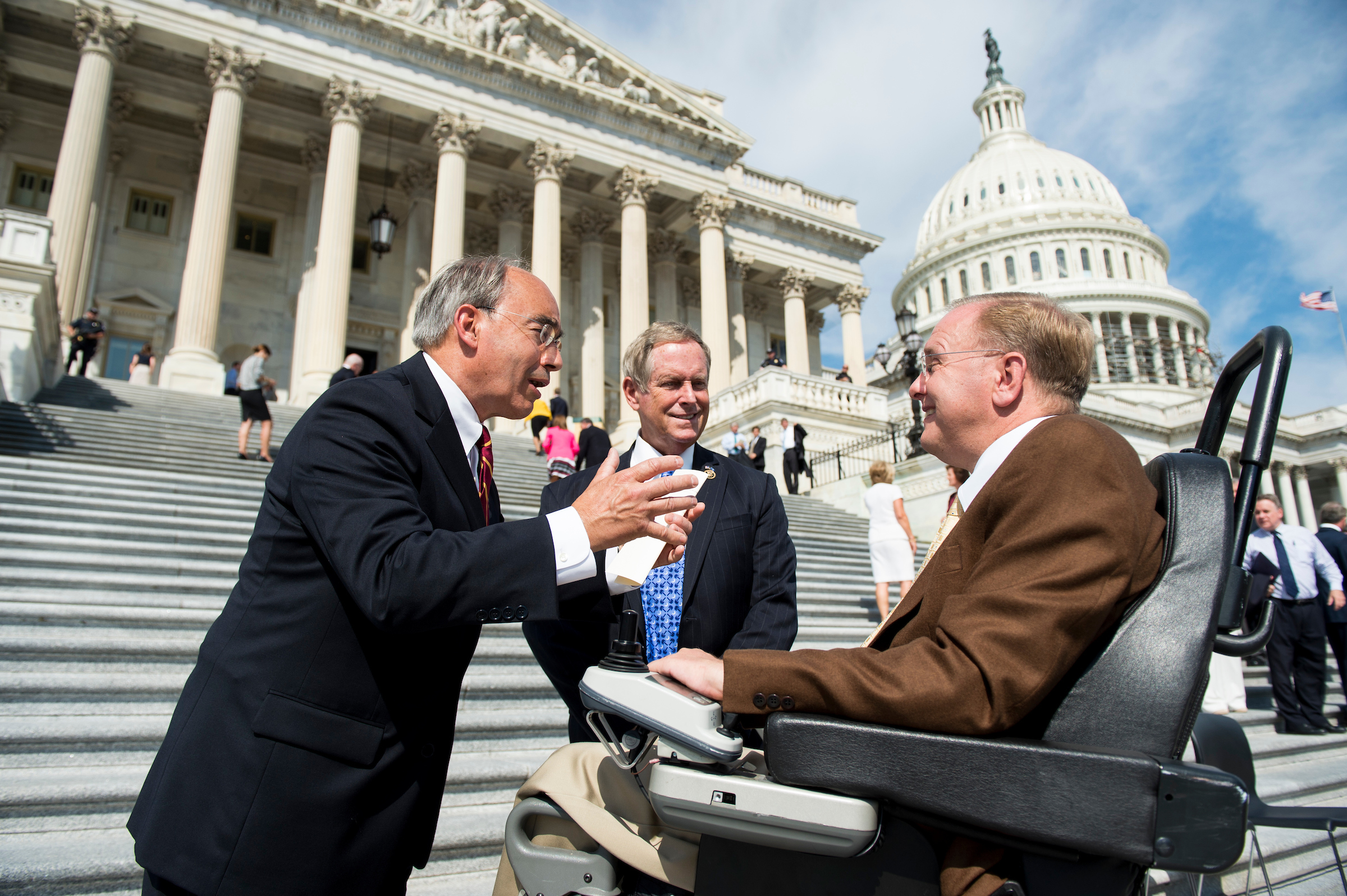 Maine Rep. Bruce Poliquin, left, talks with other congressmen on the House steps in Washington on Friday. (Bill Clark/CQ Roll Call)