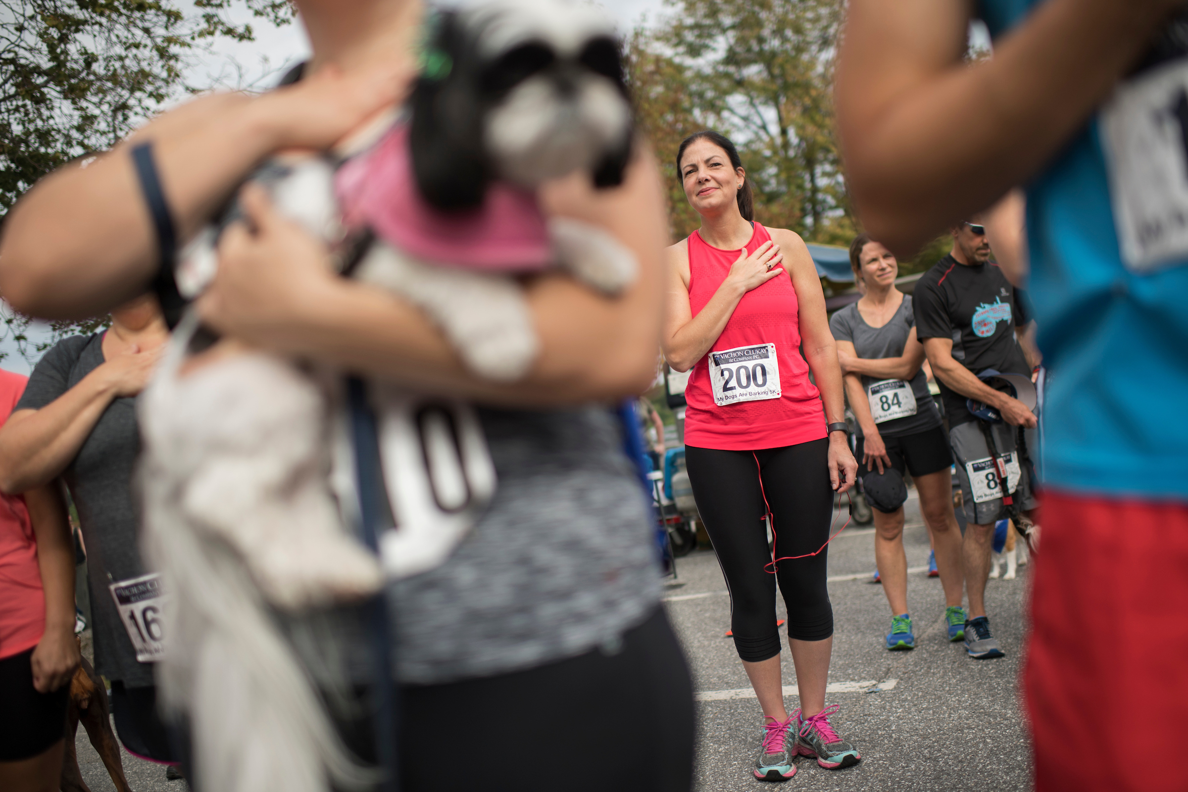 Ayotte runs a 5K almost every weekend she's home. Here she listens to the National Anthem before the My Dogs are Barking 5K race in Manchester. (Tom Williams/CQ Roll Call)