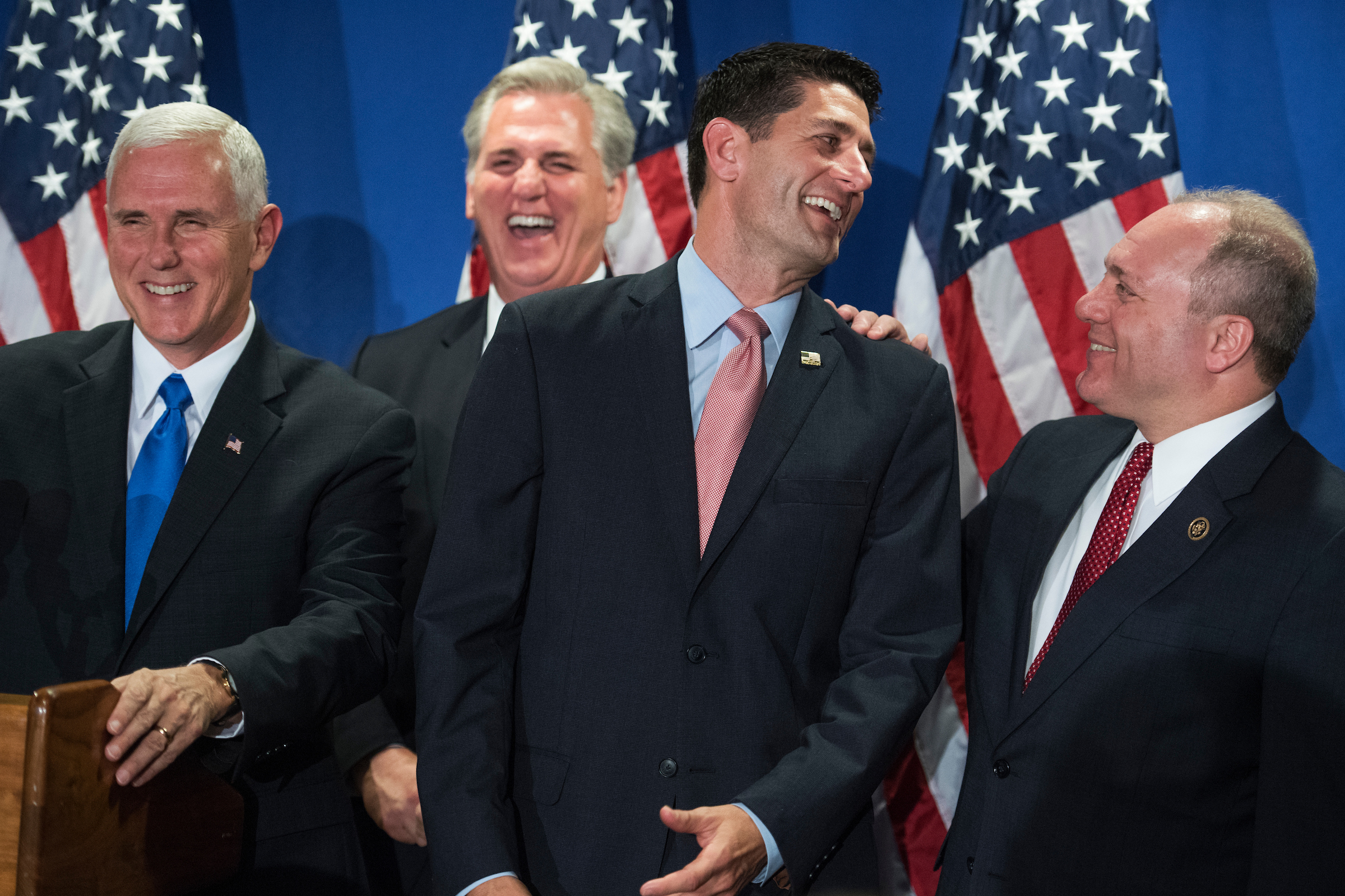 From left, Republican vice presidential nominee Mike Pence, House Majority Leader Kevin McCarthy, Speaker Paul D. Ryan and House Majority Whip Steve Scalise share a laugh with the media after a meeting of the House Republican Conference at the Republican National Committee on Tuesday, Sept. 13, 2016. (Tom Williams/CQ Roll Call)