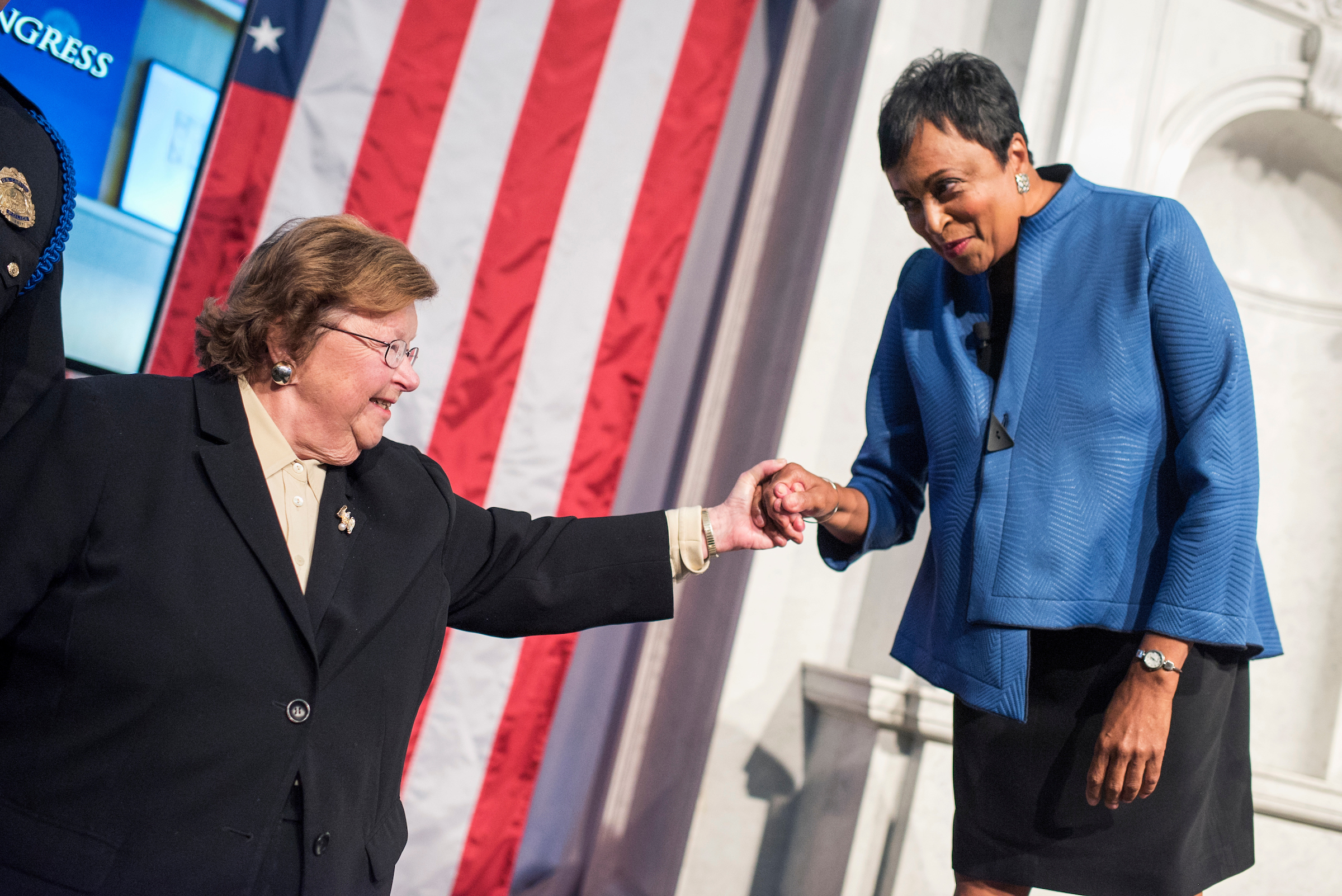 Maryland Sen. Barbara A. Mikulski, left, greets Carla Hayden during her swearing-in ceremony as Librarian of Congress in the Great Hall of the Thomas Jefferson Building on Wednesday, September 14, 2016. (Tom Williams/CQ Roll Call)