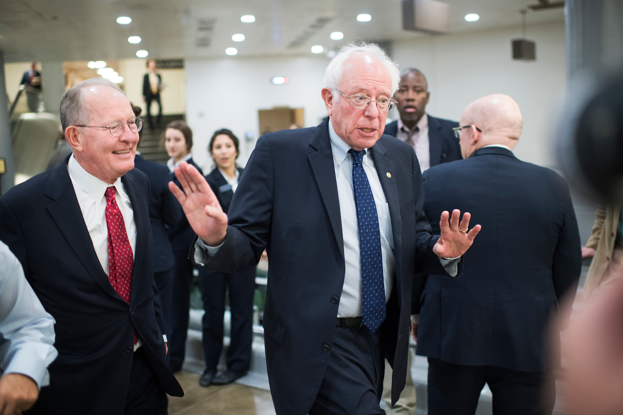 Sens. Bernie Sanders of Vermont, right, and Lamar Alexander of Tennessee decline to talk to a reporter in the Senate subway on Thursday, Sept. 15, 2016. (Tom Williams/CQ Roll Call)