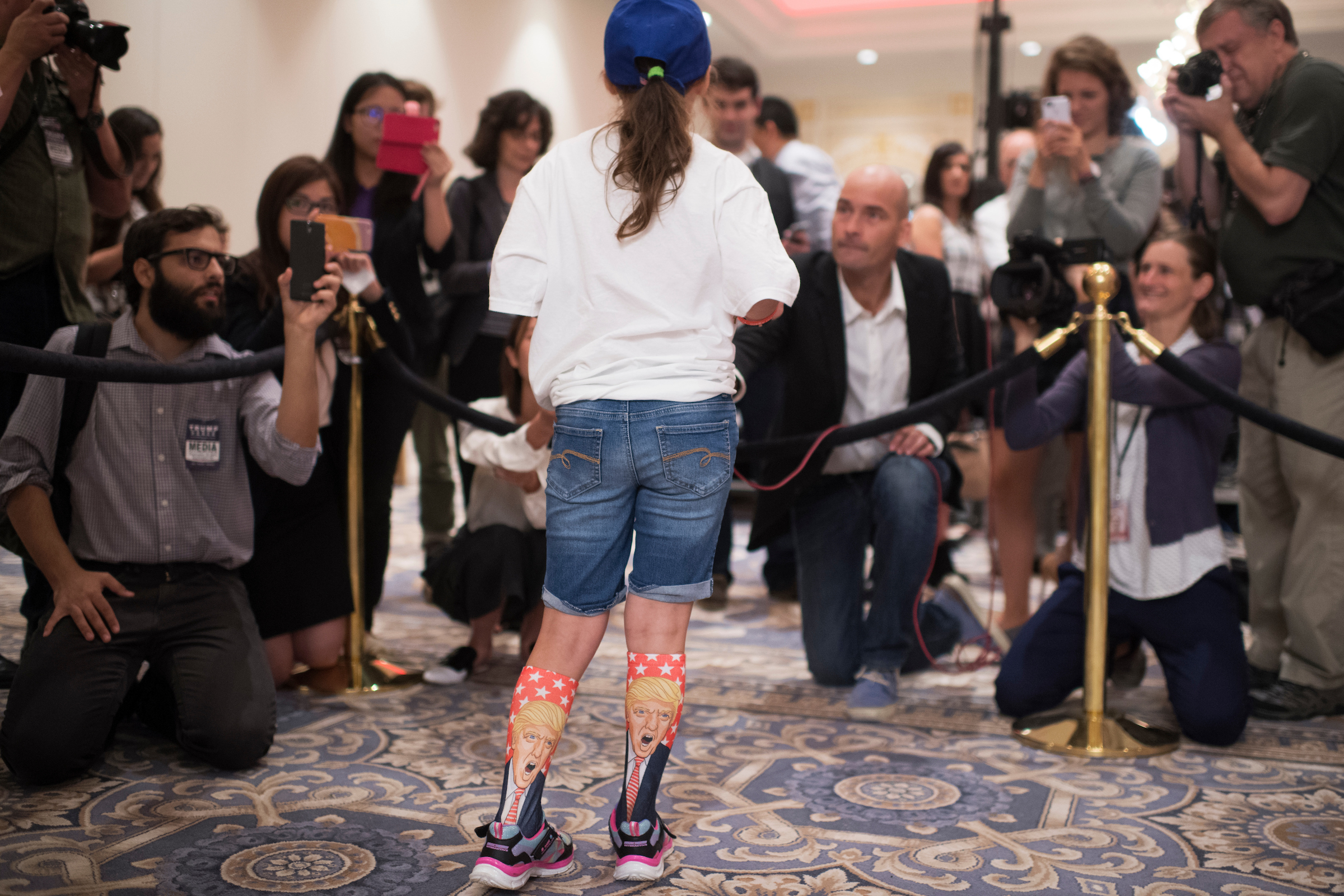 Millie, 11, from Virginia, conducts an impromptu press conference before a campaign event for Republican presidential candidate Donald Trump at the Trump International Hotel in Washington on Friday, Sept. 16, 2016. (Tom Williams/CQ Roll Call)