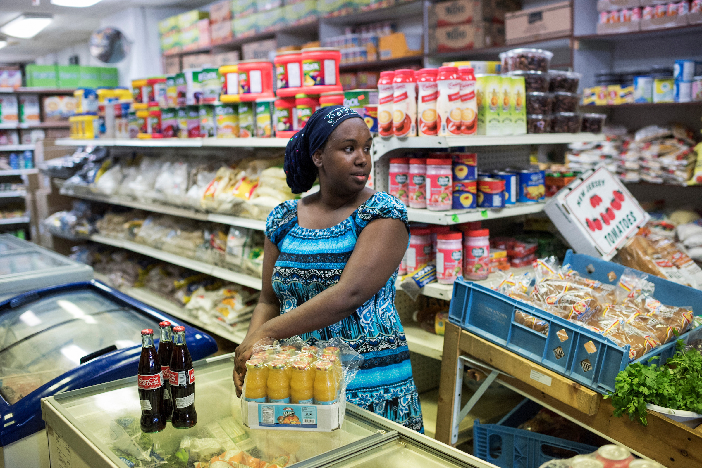 A Somali business owner stocks her store during a visit by Emily Cain, Democratic candidate for Maine's 2nd Congressional District, in Lewiston, Maine, September 8, 2016. (Tom Williams/CQ Roll Call)