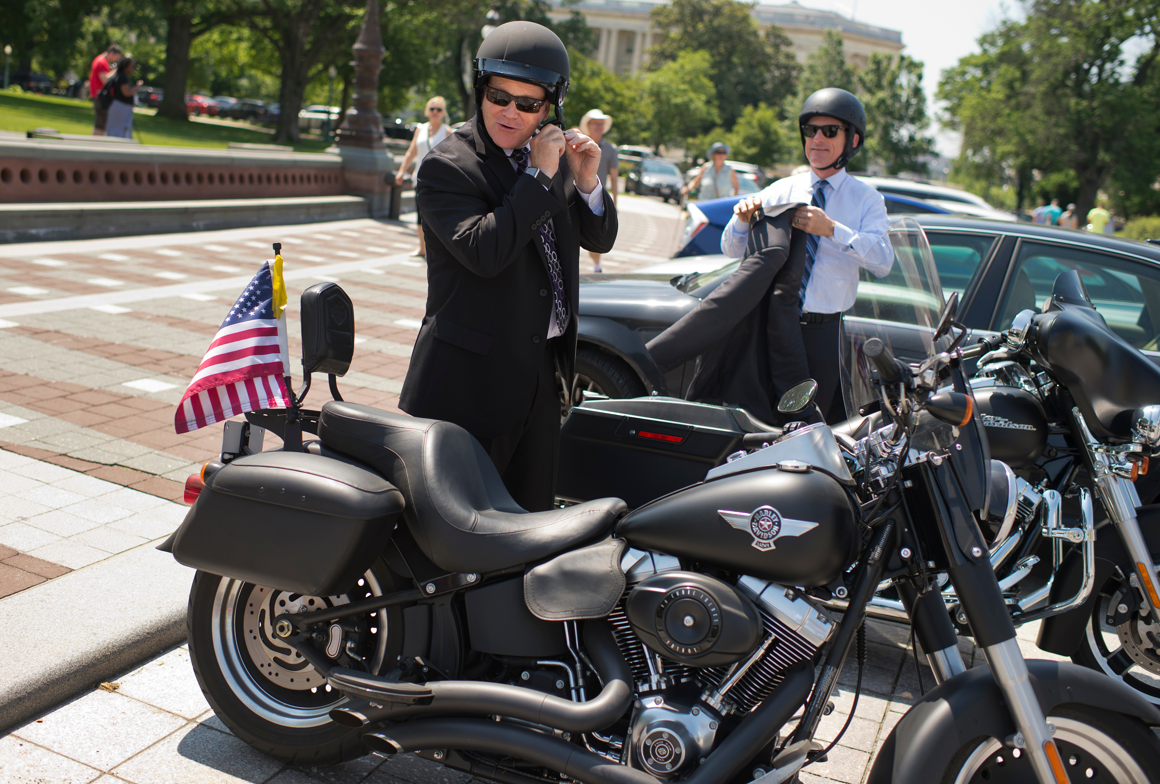UNITED STATES - MAY 26: Reps. Reid Ribble, R-Wis., left, and Scott Rigell, R-Va., board their Harley-Davidson motorcycles on the East Front of the Capitol after the last votes in the House which begins the Memorial Day recess, May 26, 2016. (Photo By Tom Williams/CQ Roll Call)