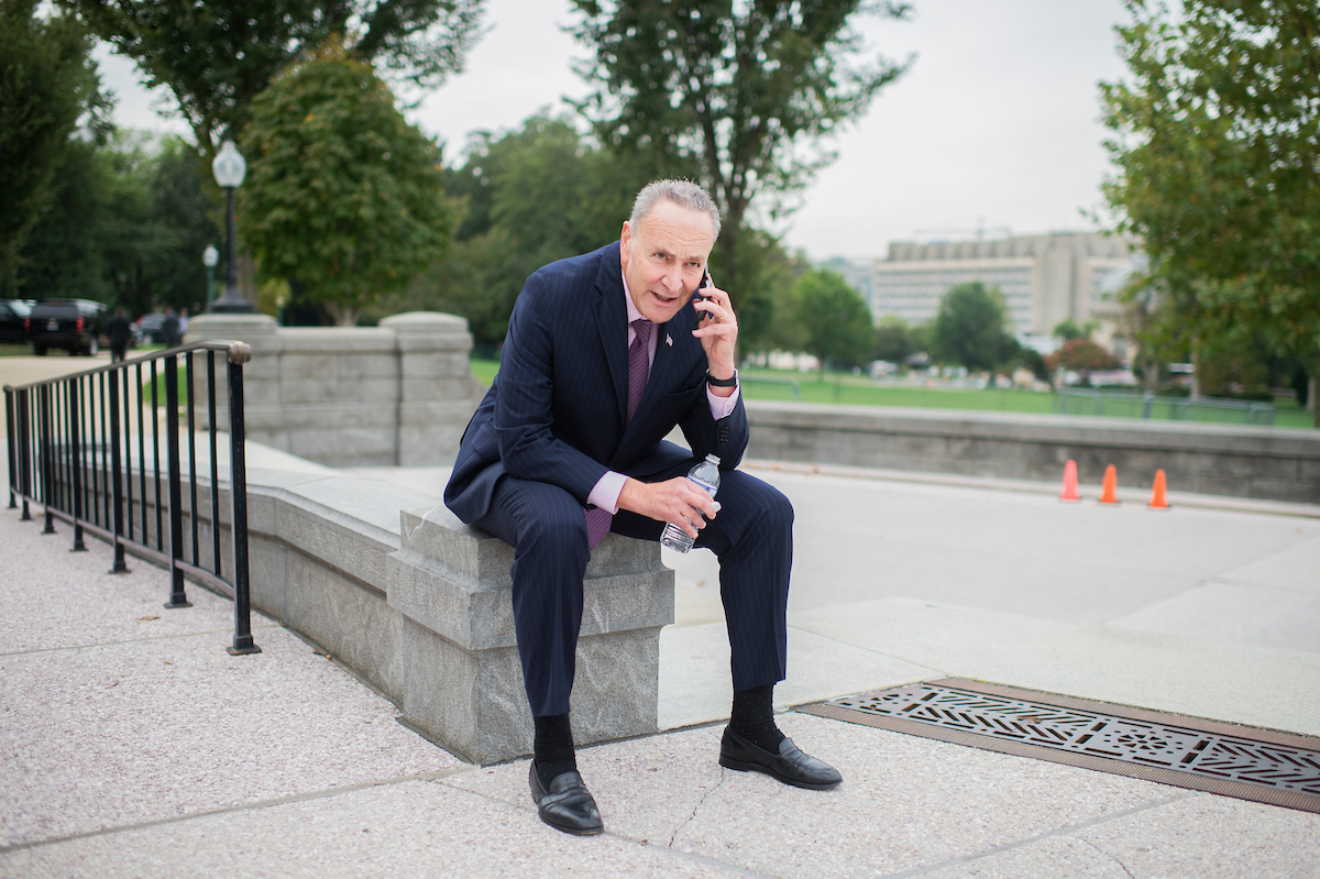 Schumer prepares to participate in the First Nail ceremony on Wednesday, Sept. 21. (Tom Williams/CQ Roll Call)
