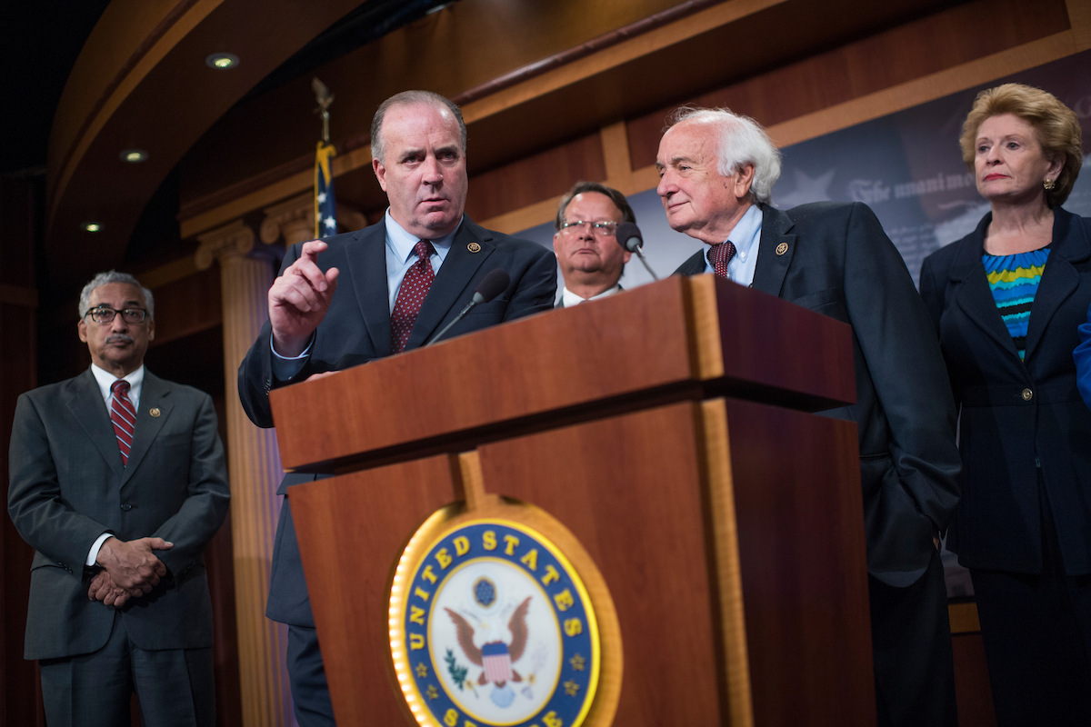 From left, Virginia Rep. Robert C. Scott and Michigan lawmakers, Rep. Dan Kildee, Sen. Gary Peters, Rep. Sander M. Levin and Sen. Debbie Stabenow, attend a news conference on Tuesday, Sept. 27, in the Capitol to call for aid for the Flint water crisis be included in the stopgap government funding bill. (Tom Williams/CQ Roll Call)