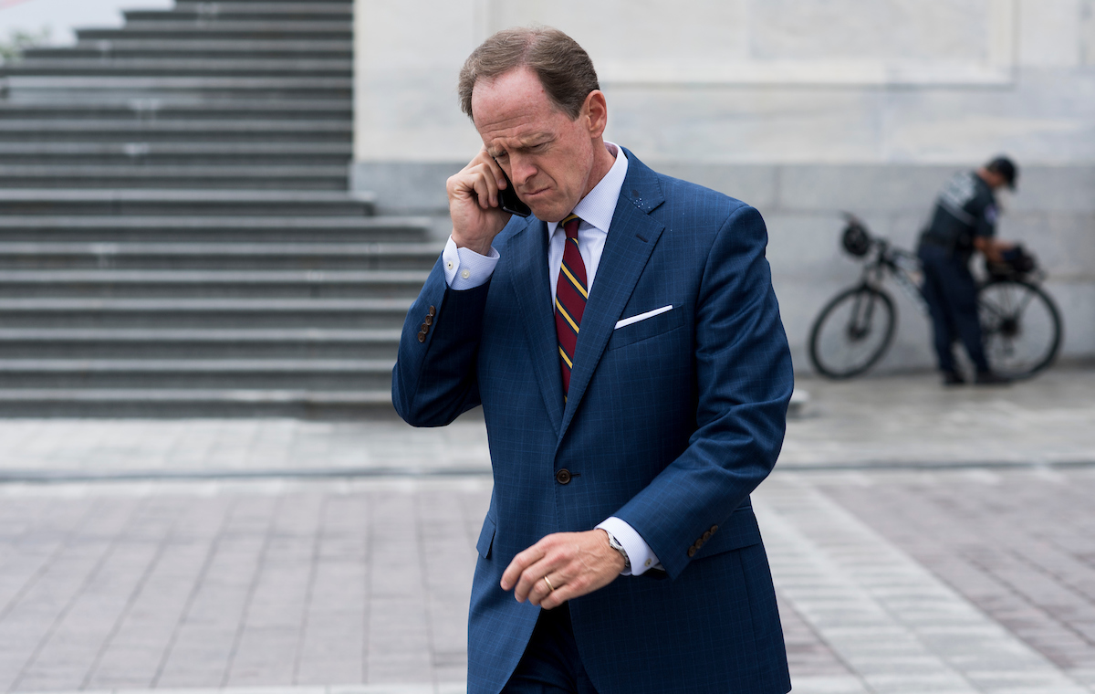 Toomey leaves the Capitol on Wednesday, Sept. 28, in between the last Senate votes before the election recess. (Bill Clark/CQ Roll Call)