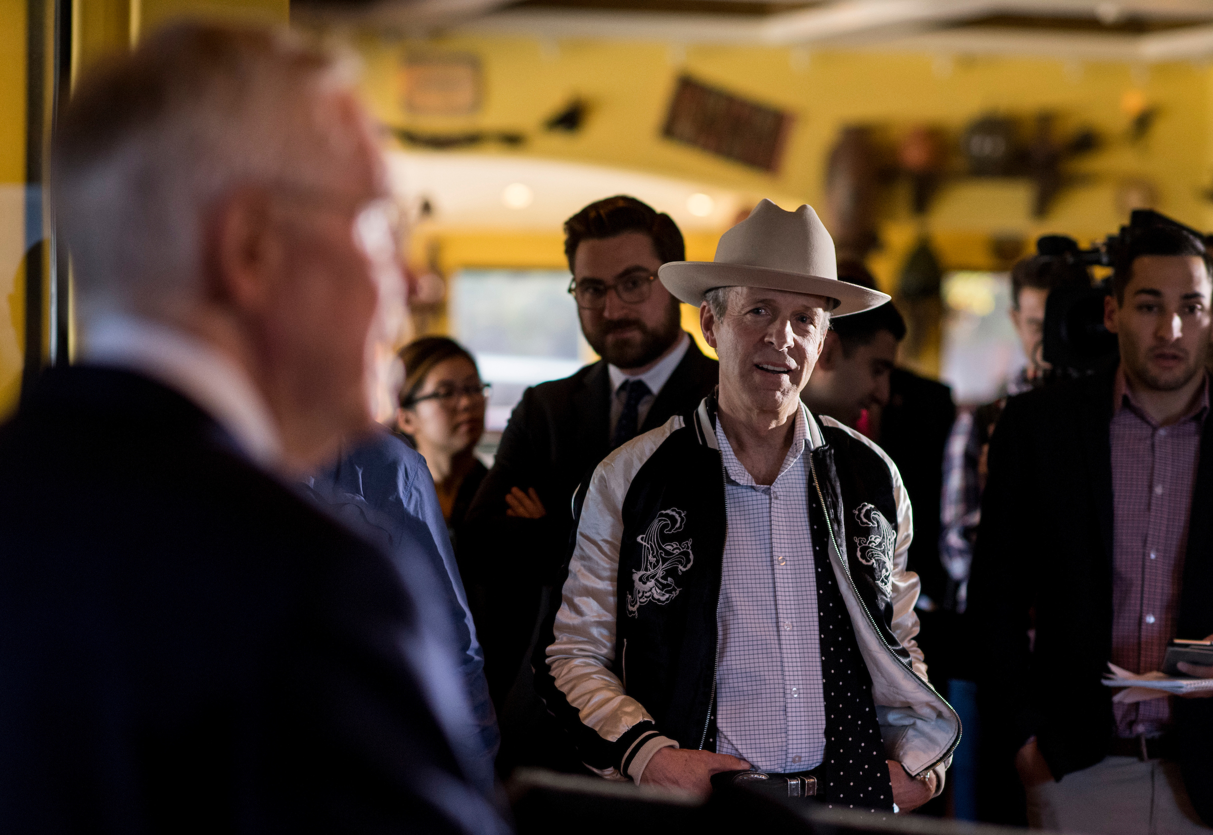 "Mark McKinnon, with the Showtime series ""The Circus,"" center, listens as Reid holds a news conference at the Lindo Michoacan restaurant in Henderson, Nevada, on Tuesday. (Bill Clark/CQ Roll Call)"