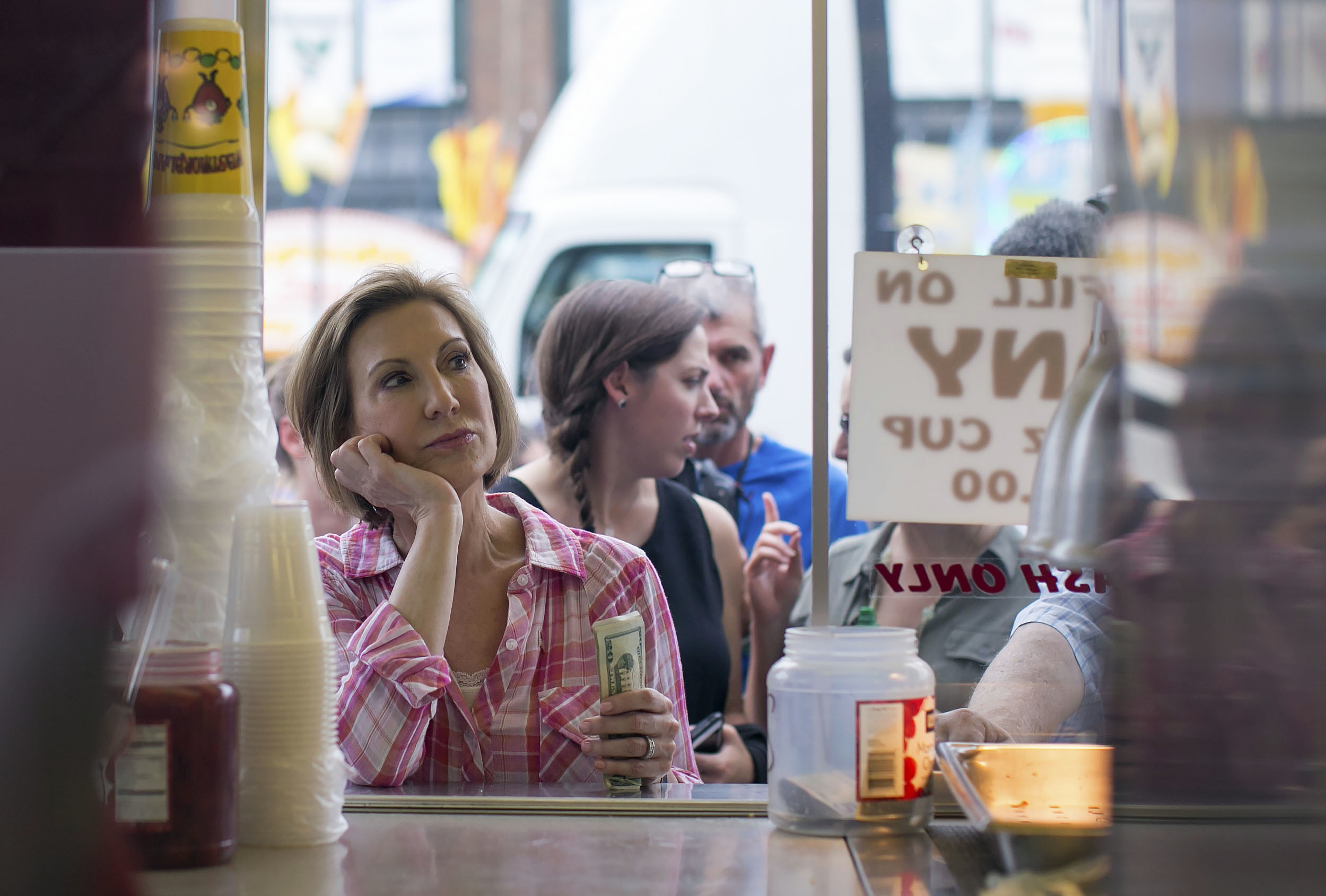 "Aug. 17, 2015: Republican presidential candidate Carly Fiorina waits her turn in line to purchase a ""diabetic lemonade"" at the Iowa State Fair in Des Moines. Florina's husband, Frank, was recently diagnosed with diabetes and Florina has agreed to quit sugar with him. (Al Drago/CQ Roll Call file photo)"