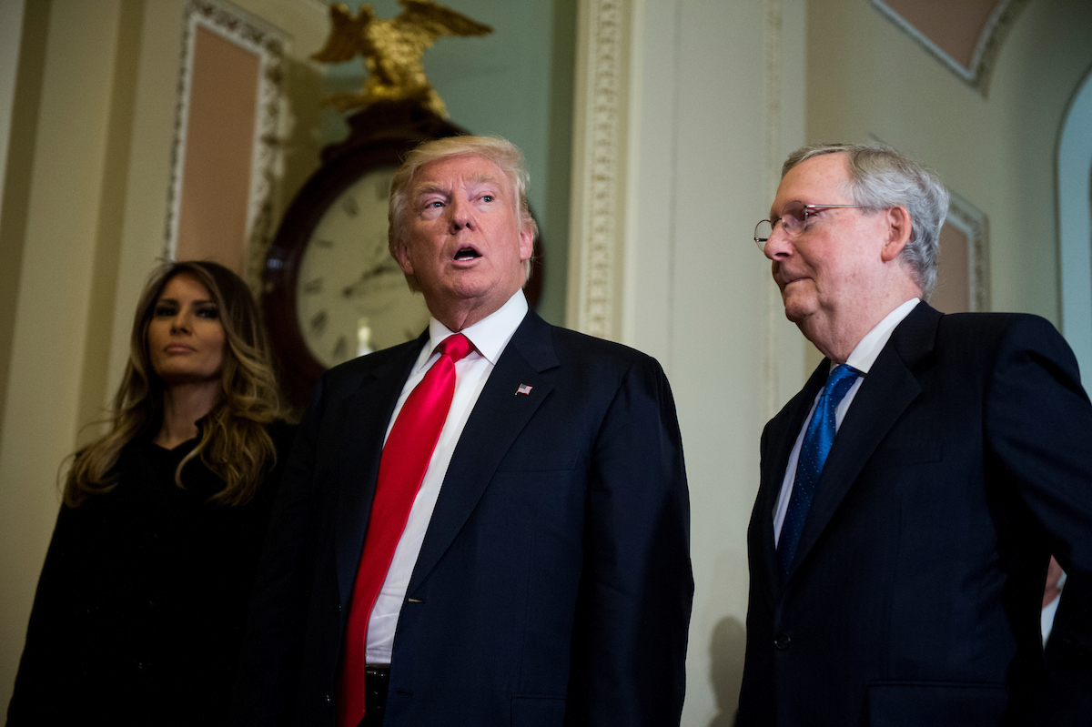 President-elect Donald Trump, escorted by Senate Majority Leader Mitch McConnell, R-Ky., takes a few questions from the press as he leaves with his wife Melania Trump after meeting with McConnell in the U.S. Capitol on Thursday. (Photo By Bill Clark/CQ Roll Call)