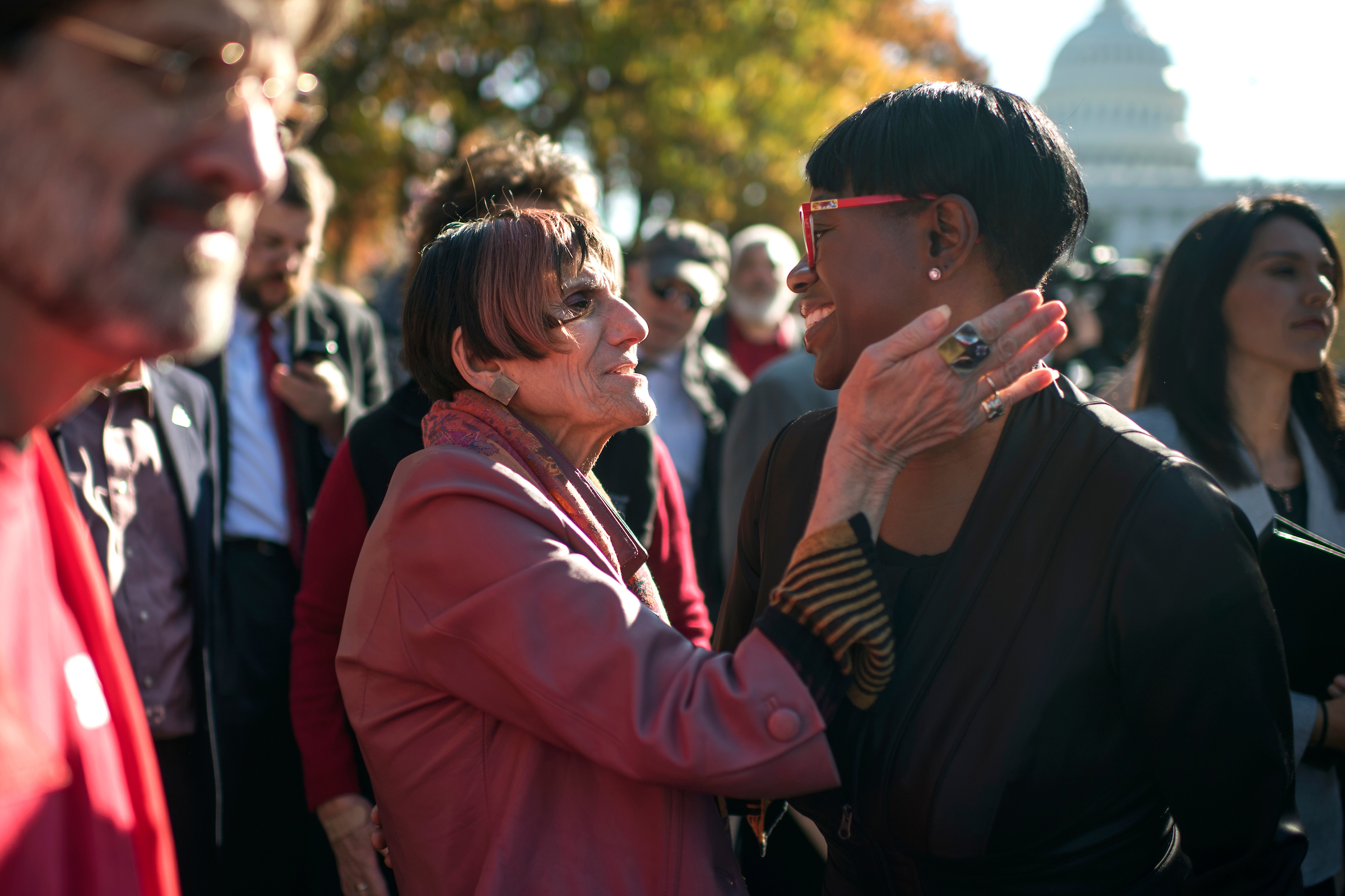 Connecticut Rep. Rosa DeLauro greets former Ohio state Sen. Nina Turner at the rally on Thursday. Hawaii Rep. Tulsi Gabbard, background right, also attended. (Tom Williams/CQ Roll Call)