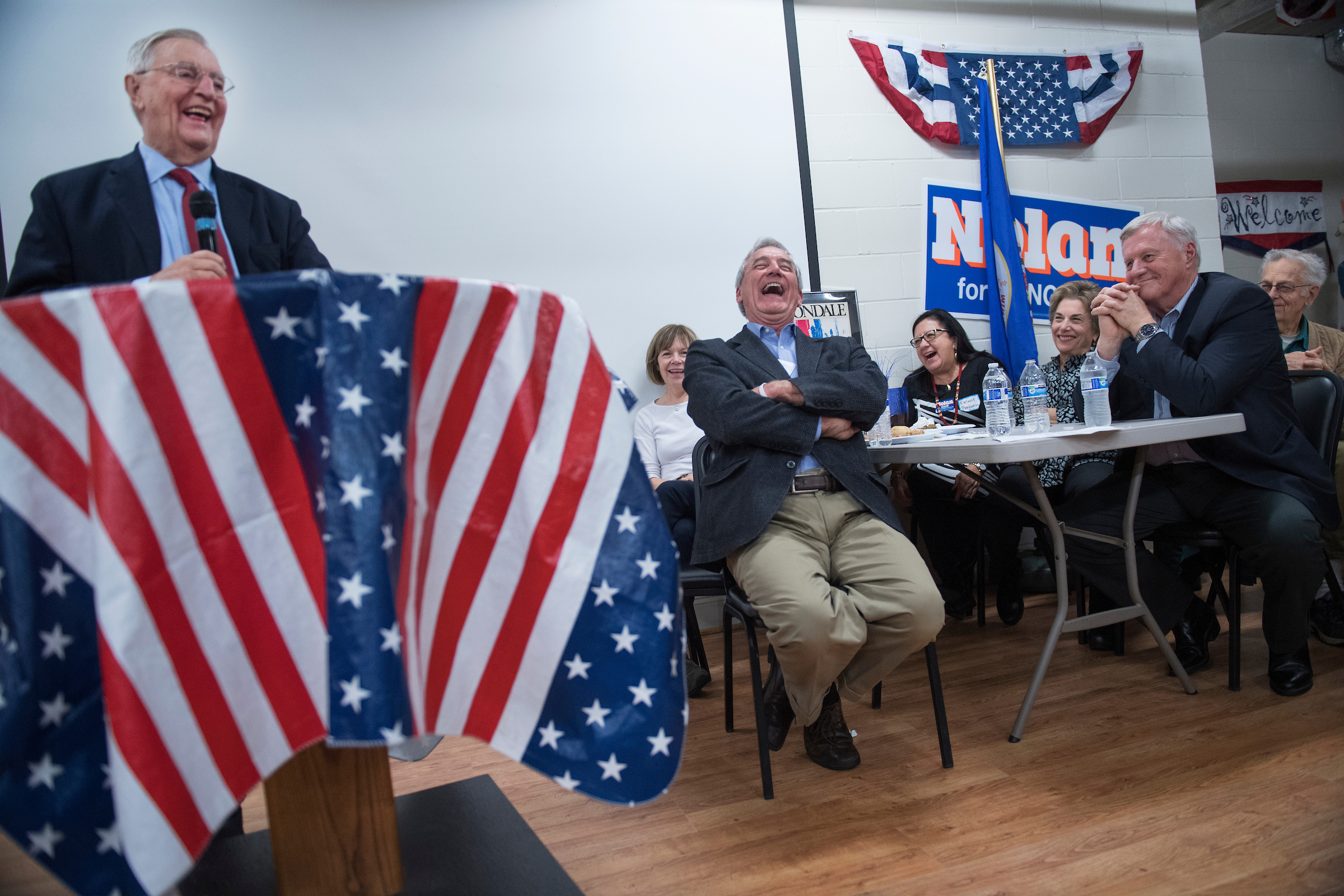 "Former Vice President Walter Mondale, left, speaks at a fish fry and fundraiser for Nolan, center, in Brainerd, Minn., on Oct. 27. Reps. Collin C. Peterson of Minnesota and <a class=""memberLink"" title=""Click to view member info in a new window"" href=""http://data.rollcall.com/members/164?rel=memberLink"" target=""_blank"">Jan Schakowsky</a> of Illinois are also pictured. (Tom Williams/CQ Roll Call)"