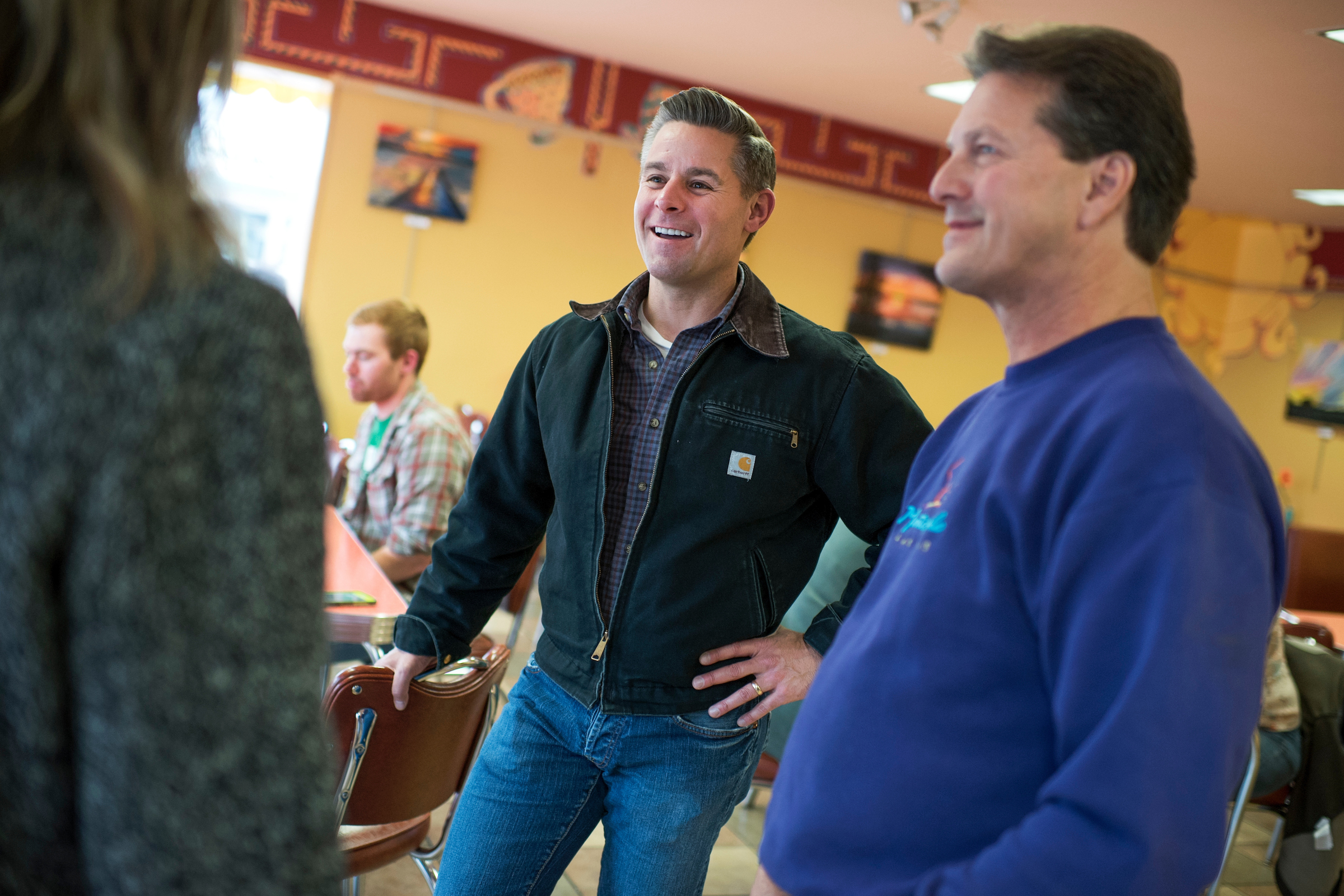 Stewart Mills, center, Republican candidate for Minnesota's 8th Congressional District, talks with voters at the Brewed Awakenings coffee shop in Grand Rapids, Minn. (Tom Williams/CQ Roll Call)