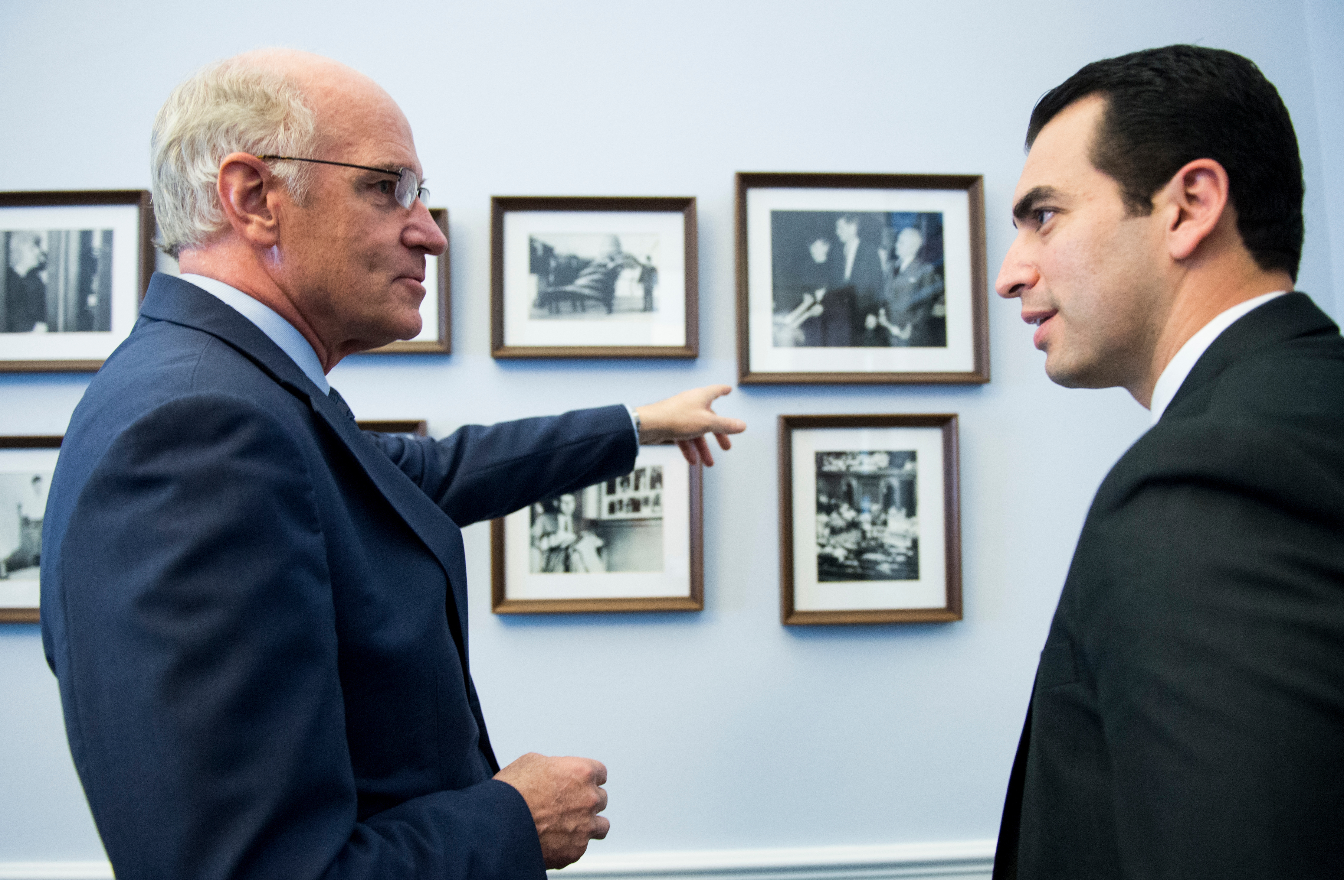 Keating points to photos of President John F. Kennedy on his office wall. Kihuen selected the office, located next door to Keating's current office. (Bill Clark/CQ Roll Call)