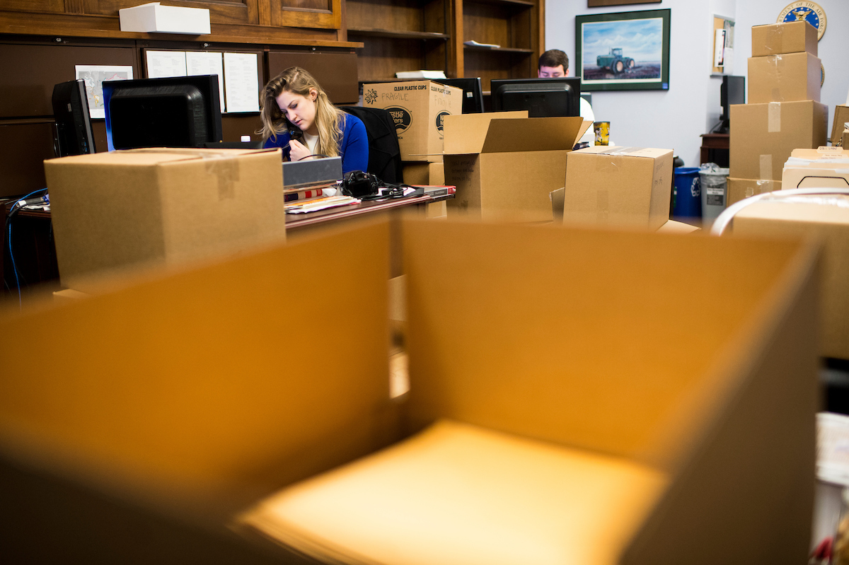 Staffers in Rep. Sam Graves' office go about regular business surrounded by moving boxes on Wednesday. The congressman is moving his Longworth House Office Building office down to the first floor as the 114th Congress comes to a close. (Photo By Bill Clark/CQ Roll Call)